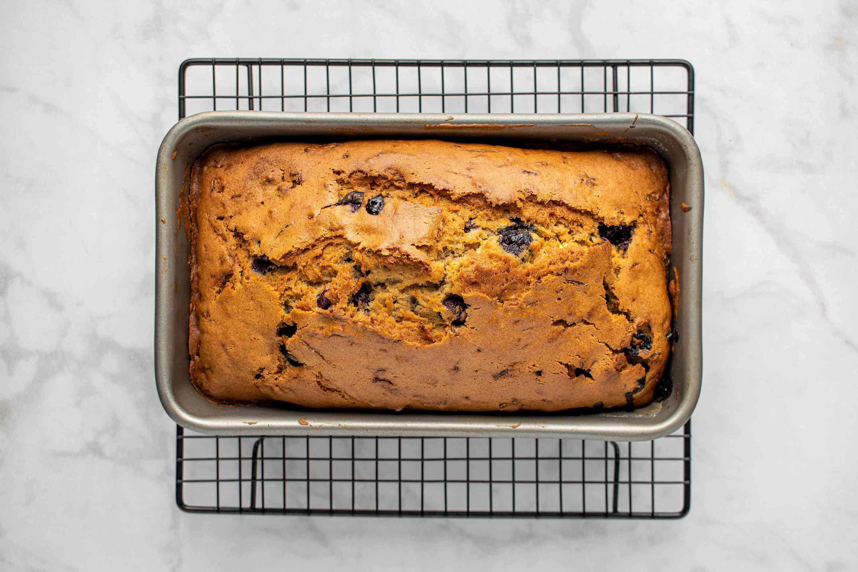Blueberry and Zucchini Quick Bread on a cooling rack