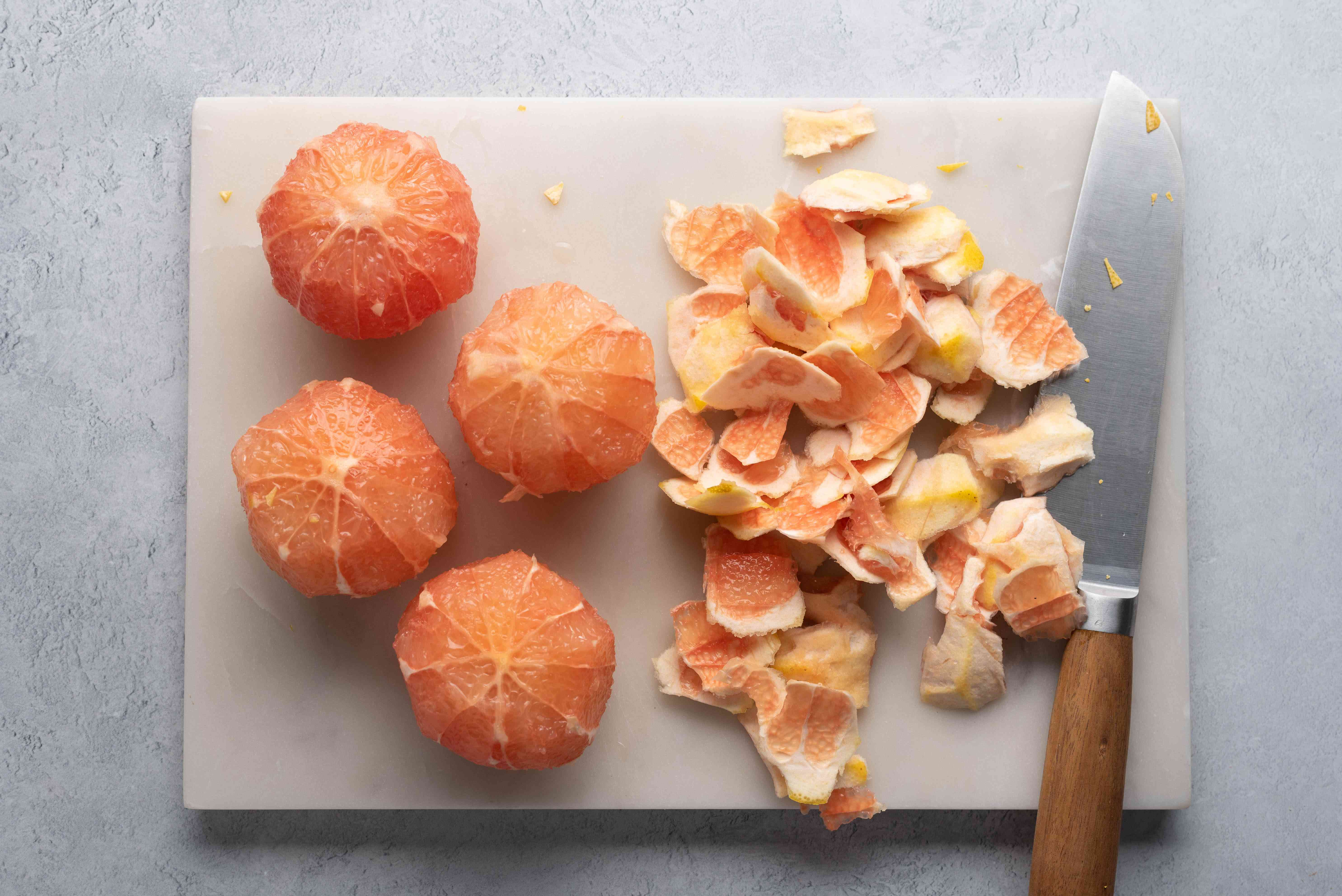 cut off the thick white pith from around each grapefruit