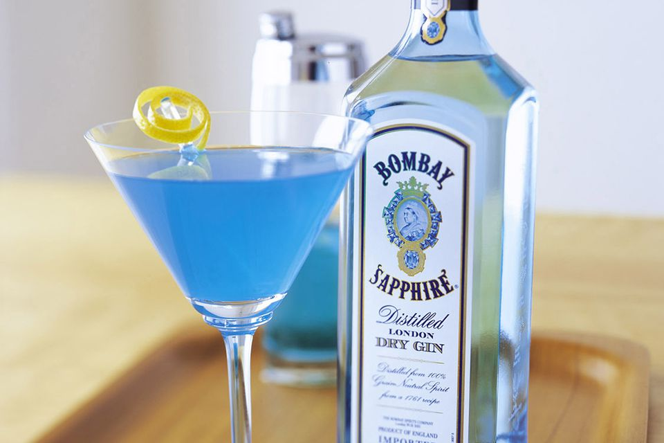 A beautiful blue martini, the Sapphire Alpine cocktail mixes up quickly, featuring Bombay Sapphire Gin with orange and peach