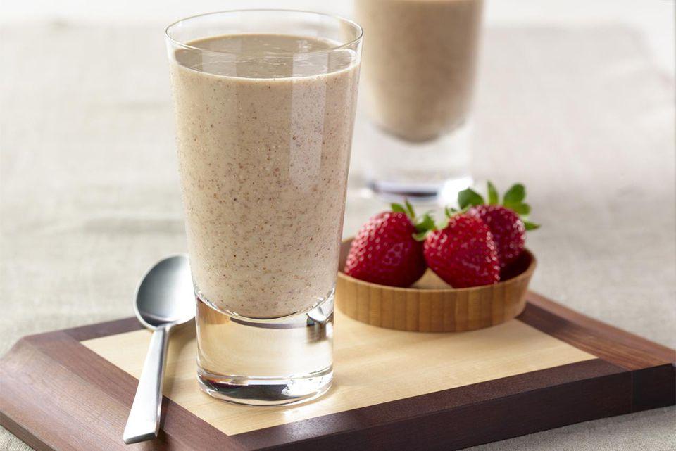 Two protein shakes next to fruit