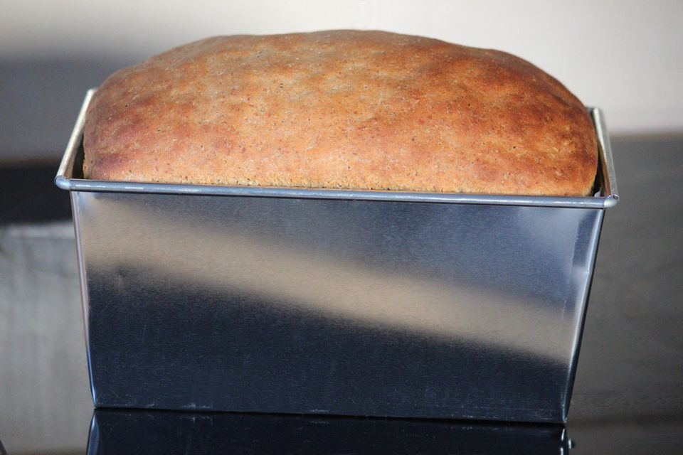 Image of homemade loaf in rectangular stainless-steel bread tin, freshly-baked