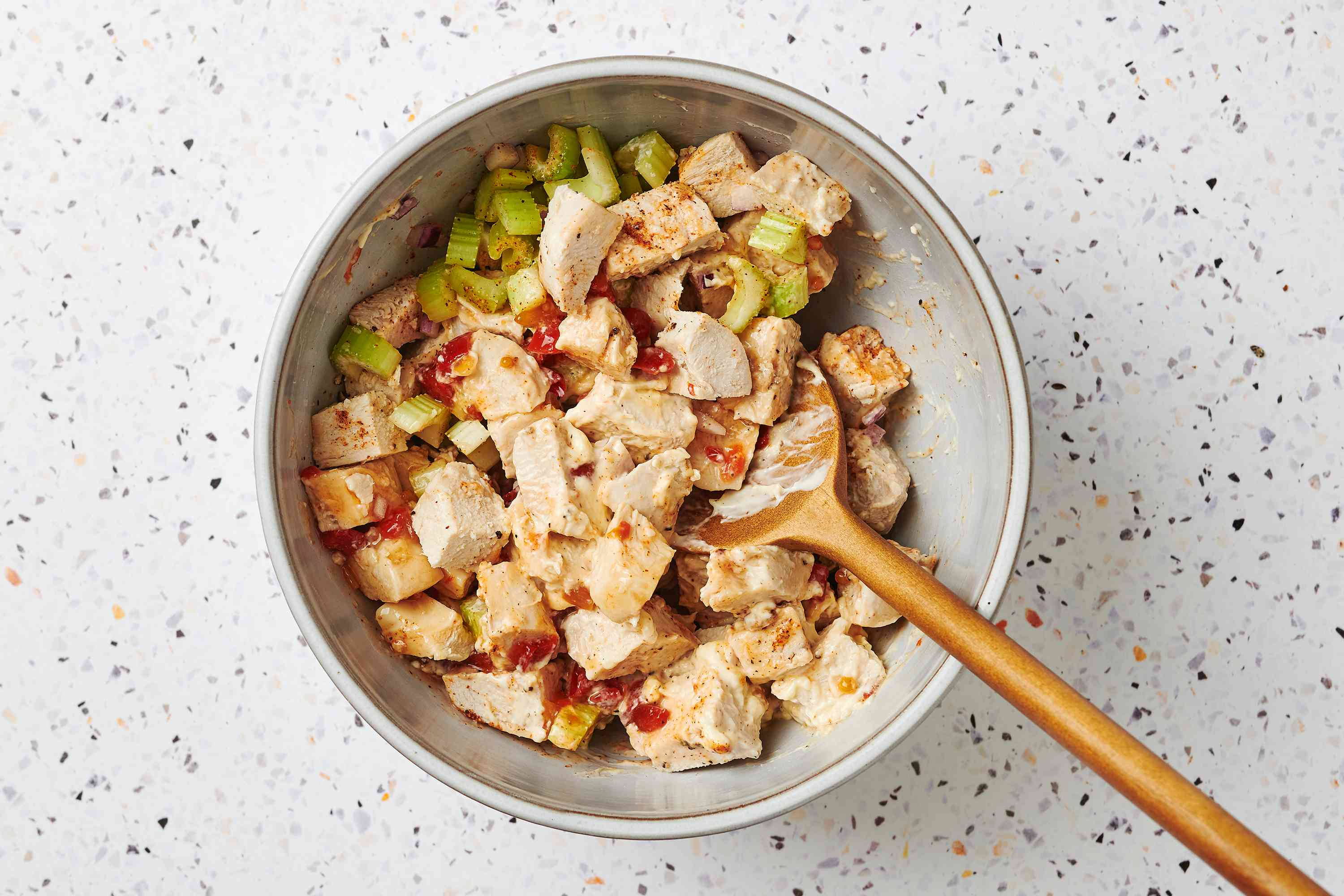 Combine chicken, celery, onion, mayonnaise, lemon juice, pepper, relish, seasoning, and salt in a bowl