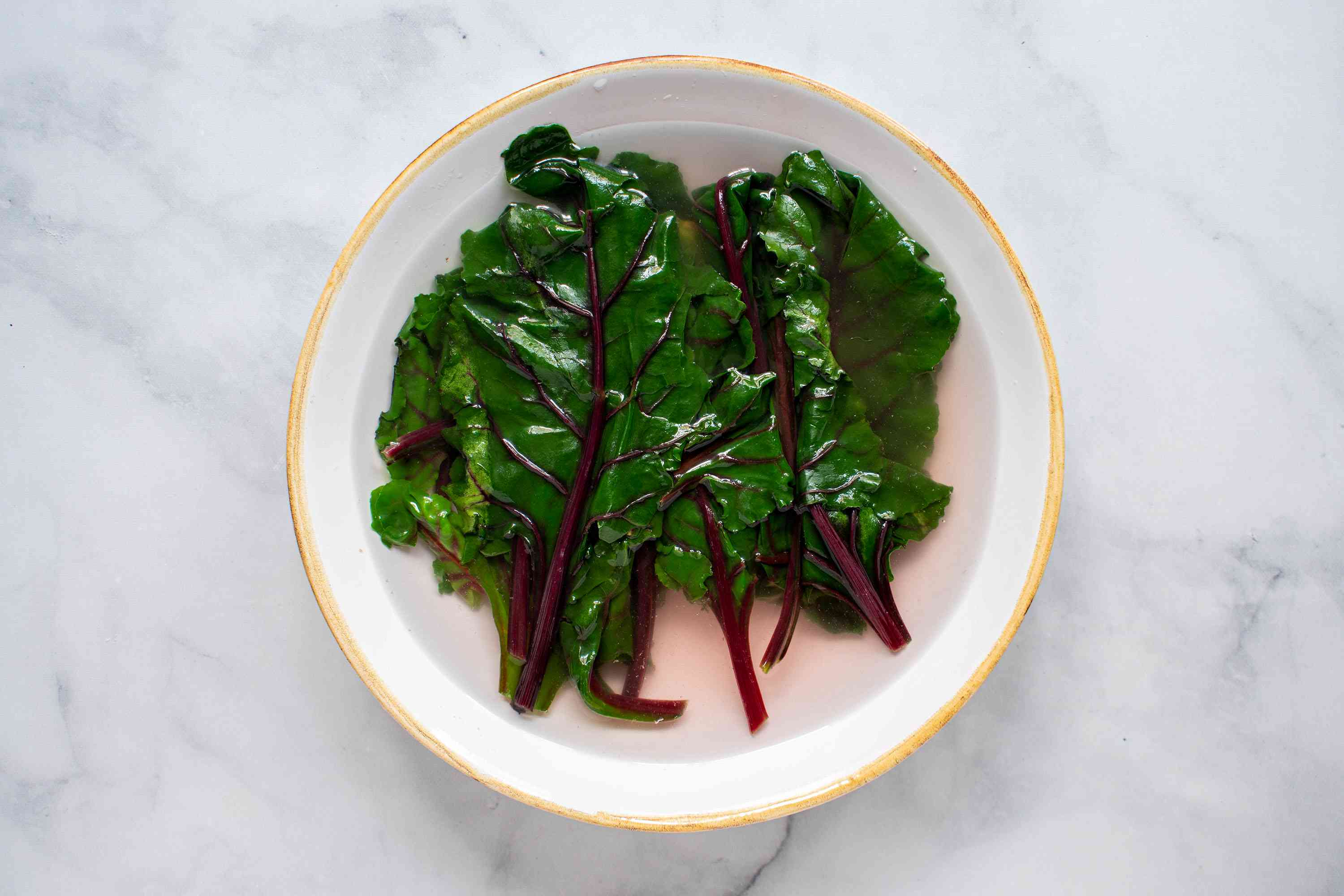 Remove the beet leaves from water and shock with cold water