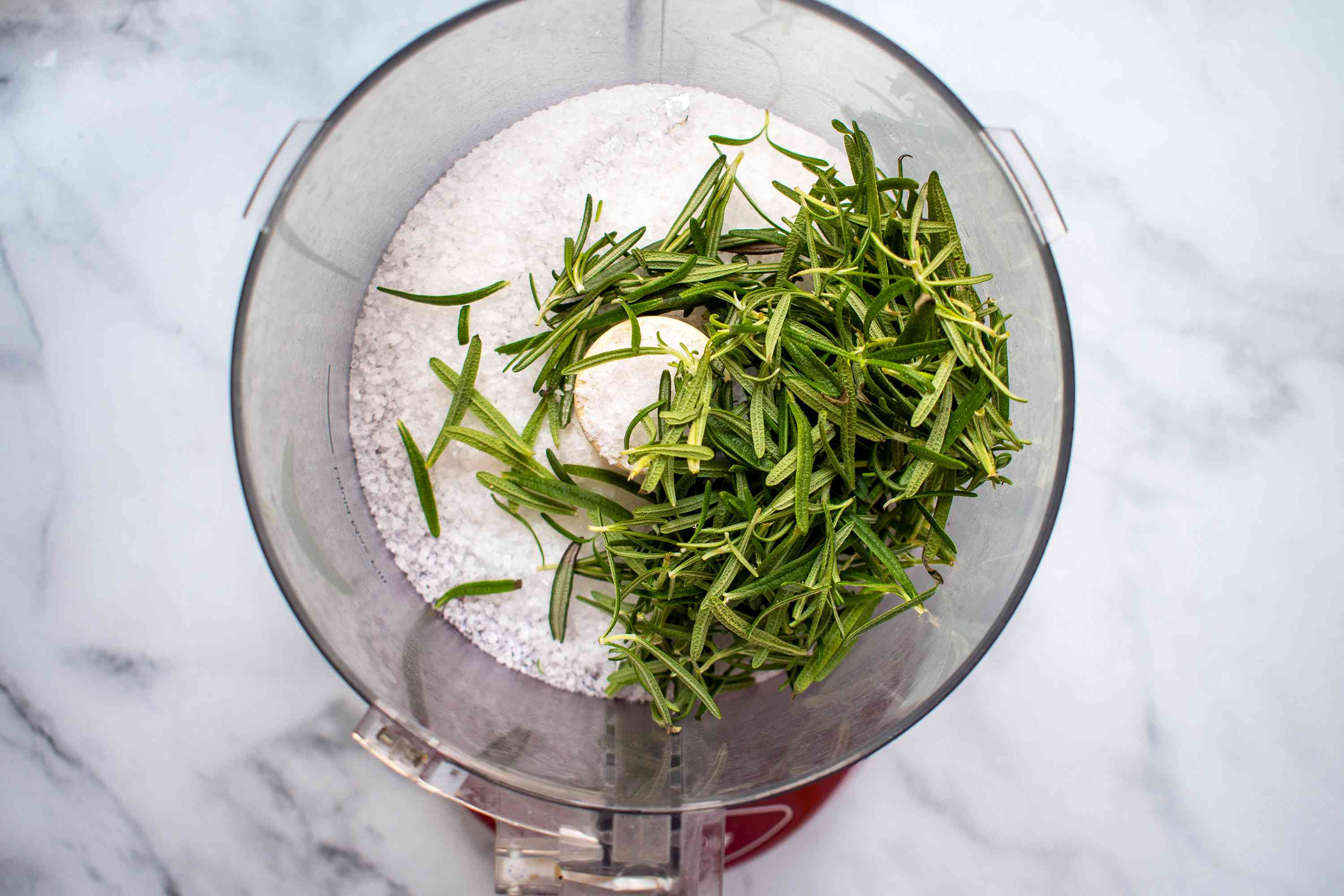 rosemary leaves and coarse salt in a food processor