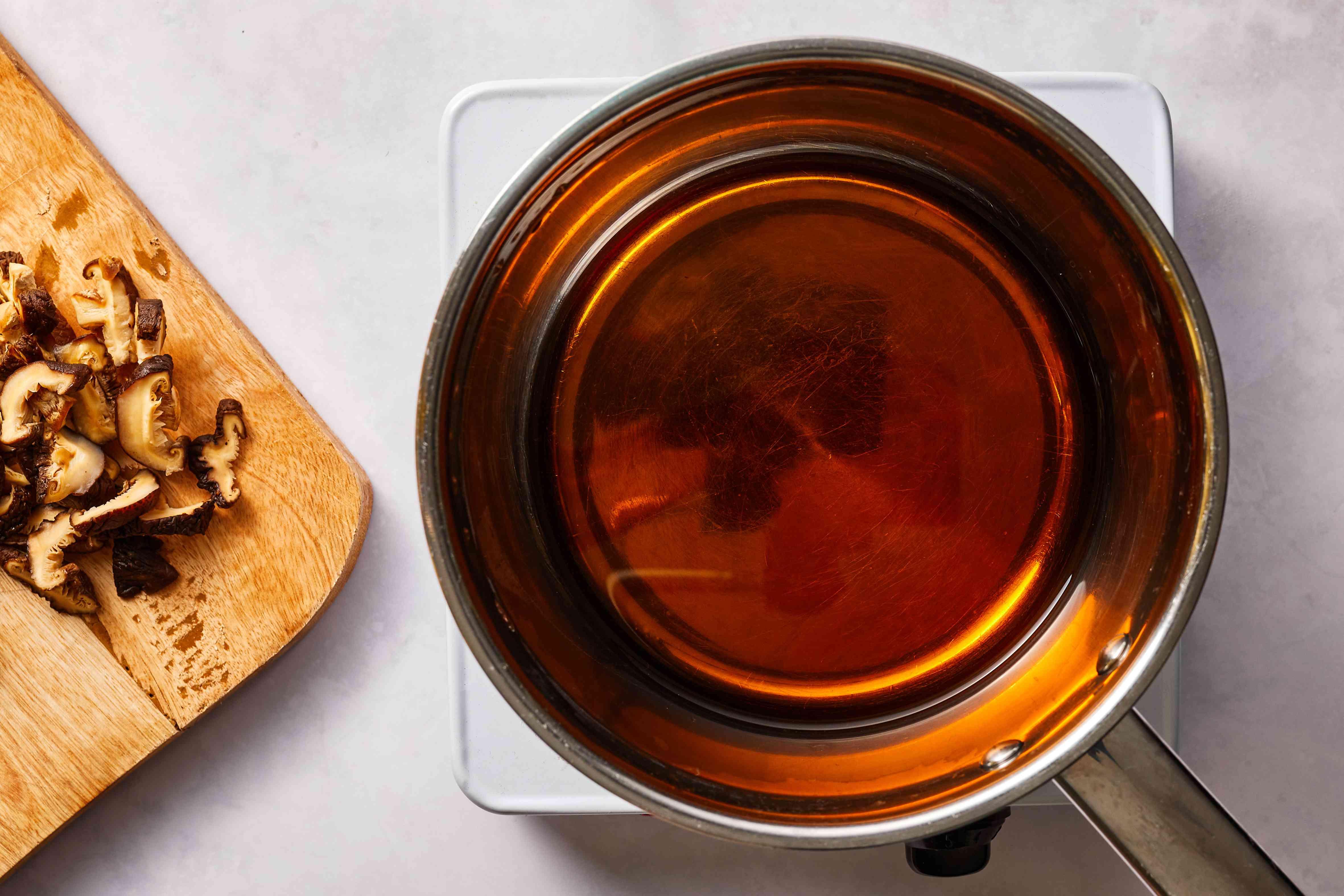 mushrooms on a cutting board, water in a pot