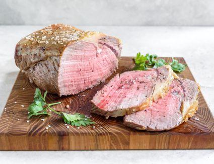 Slow-roasted prime rib roast recipe cut on a wooden board