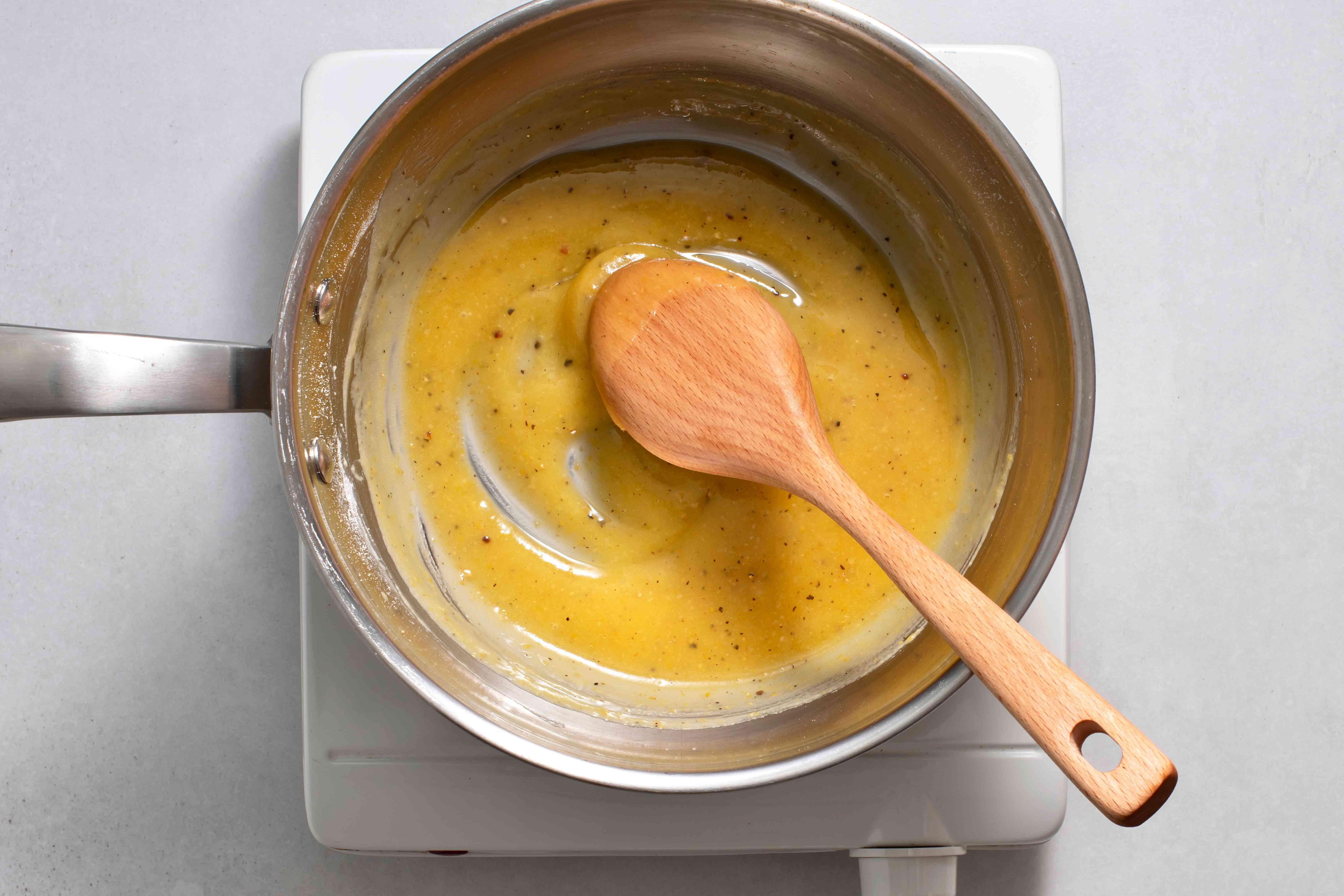 butter, mustard powder, pepper, and flour in a saucepan