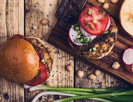 Chickpea veggie burger with fresh vegetables, Gluten-free bun
