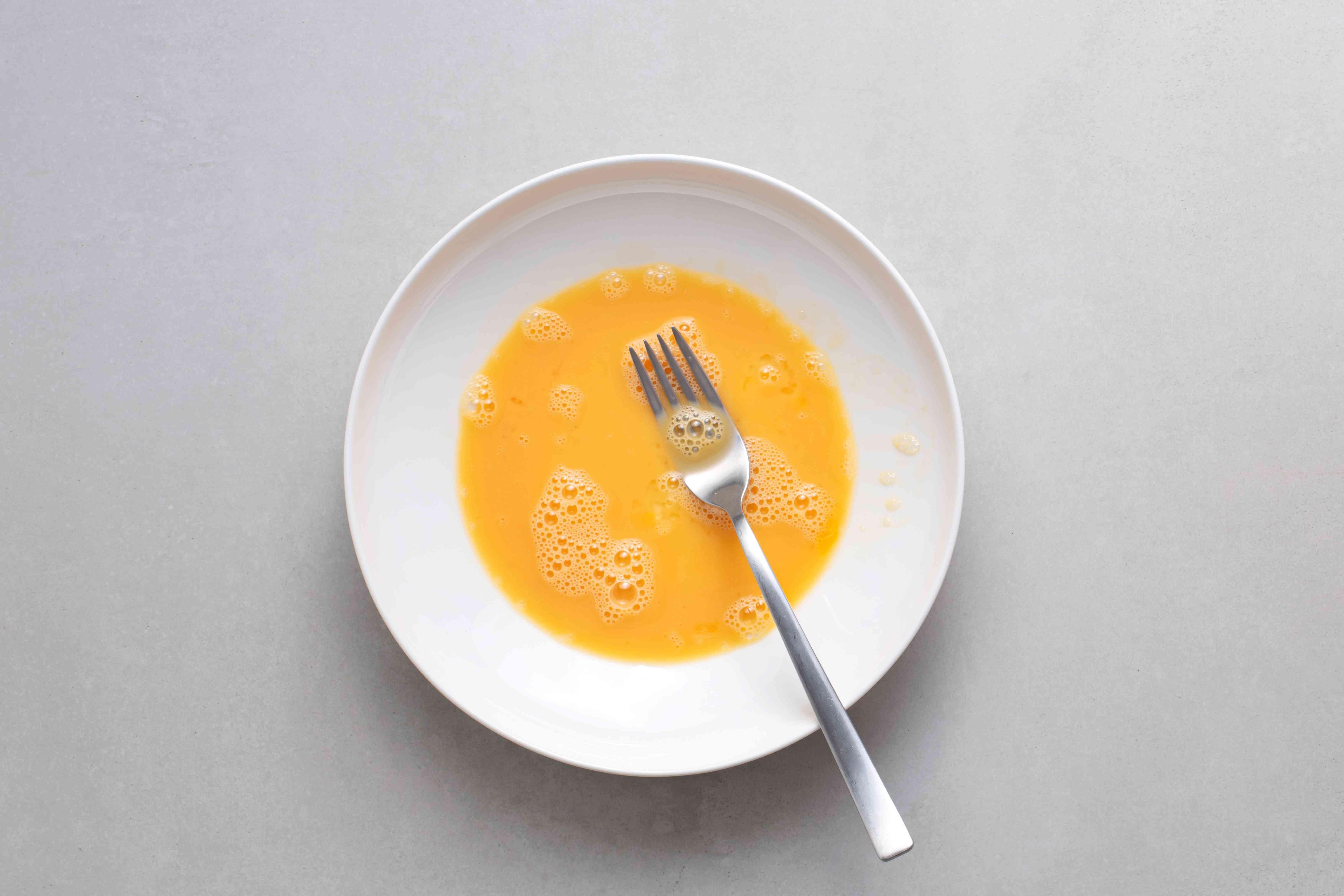 beaten egg in a bowl