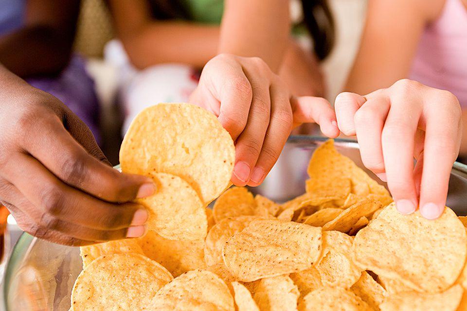 Girls eating tortilla chips