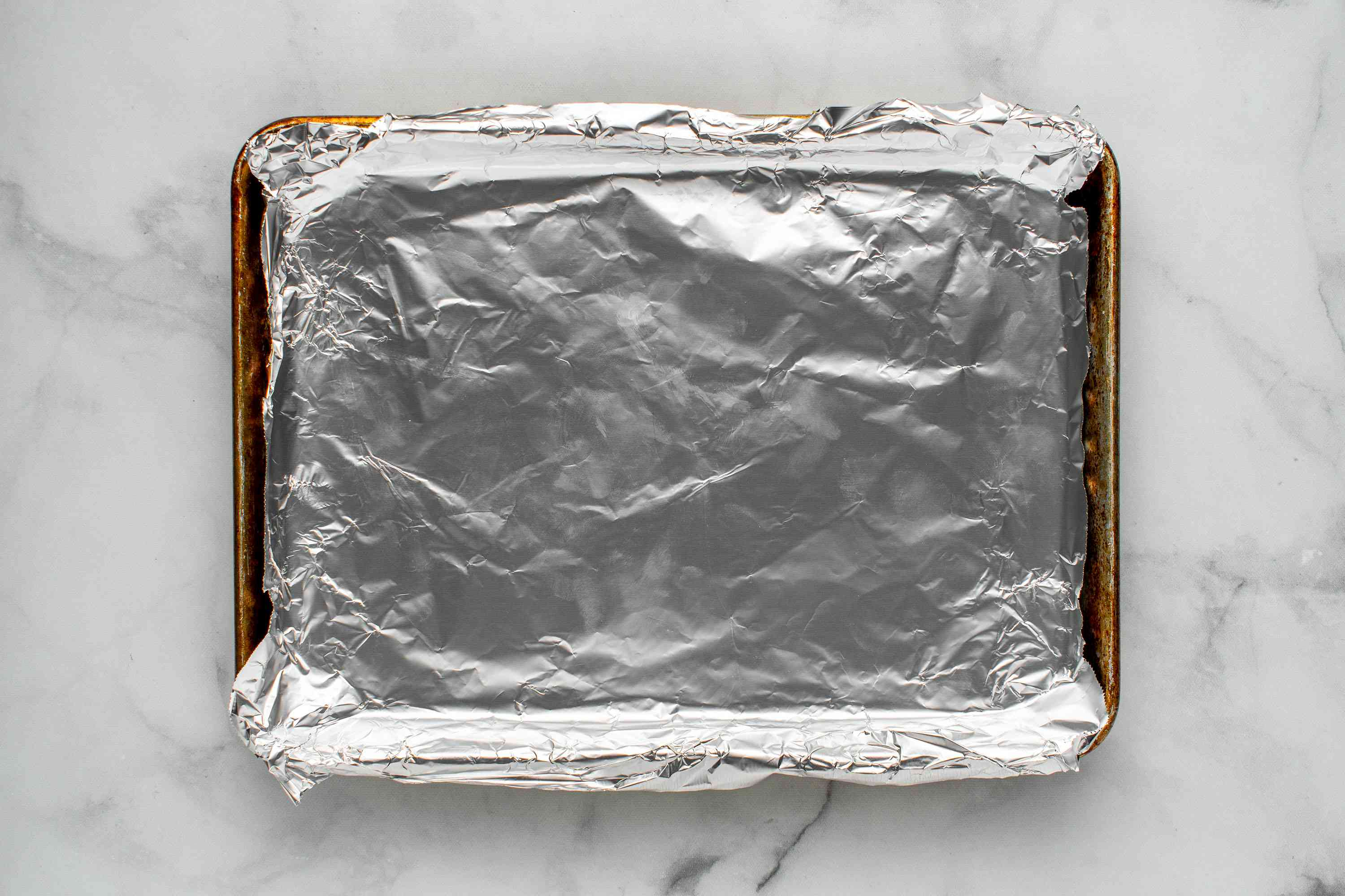 Cover a baking sheet with aluminum foil