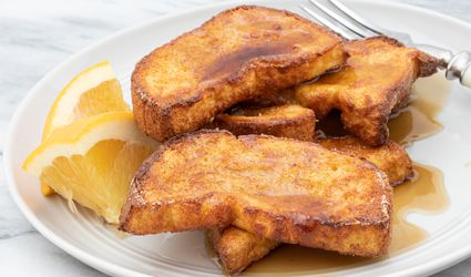 air fryer french toast on a plate with orange