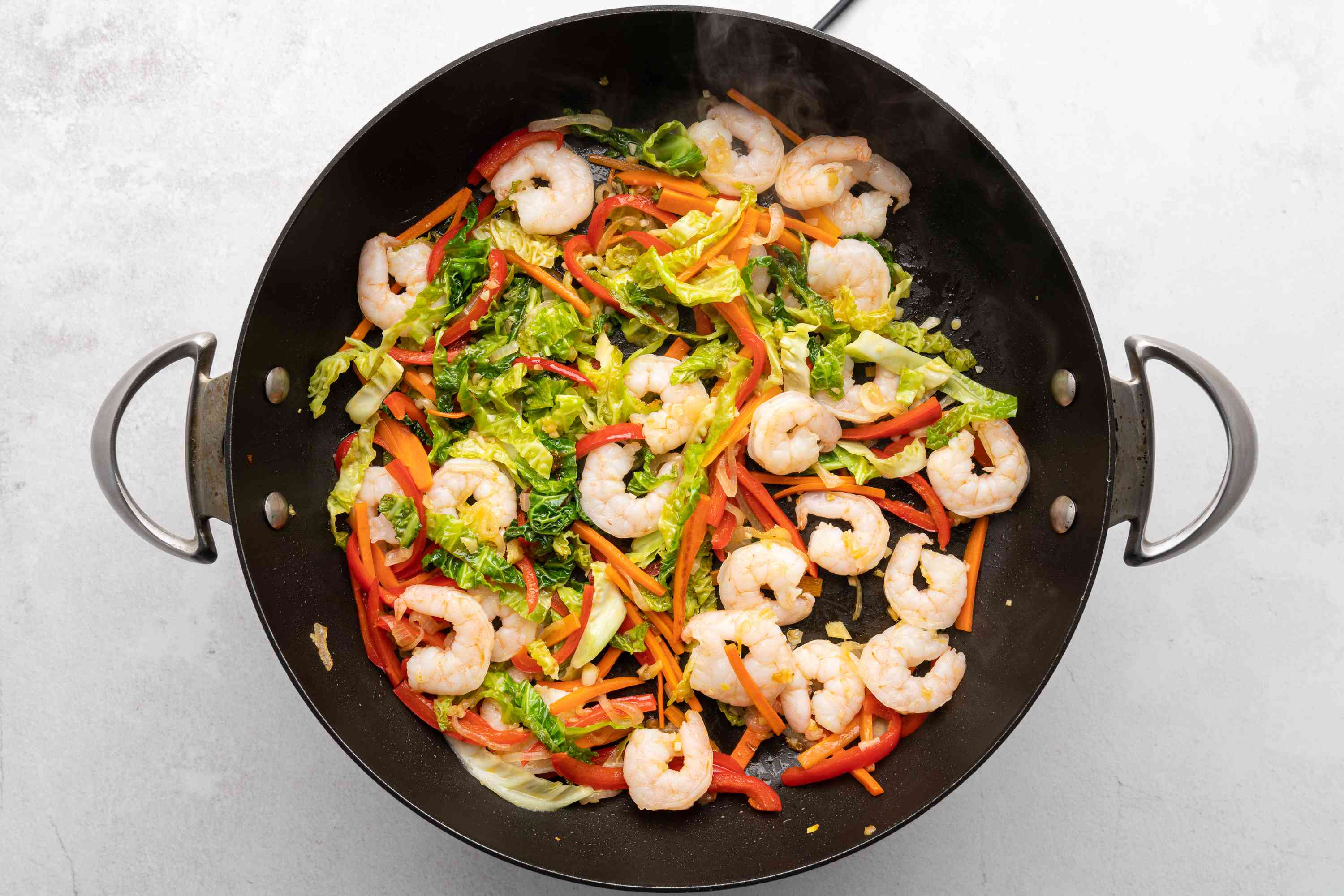shrimp and vegetable mixture in a wok