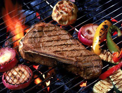 Grilling Steak and Vegetables over Lava Rocks