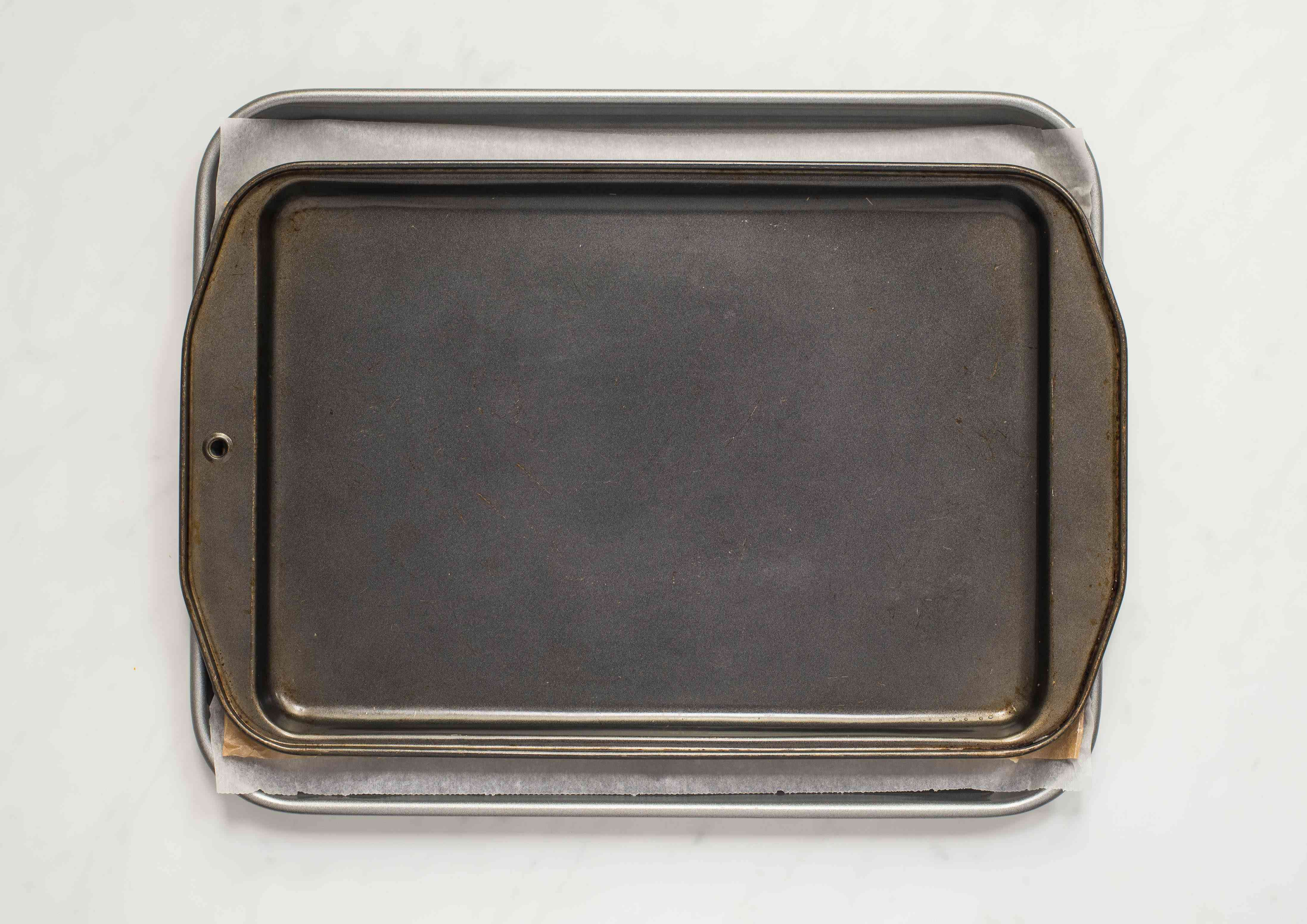 Weighing down the dough with a baking pan