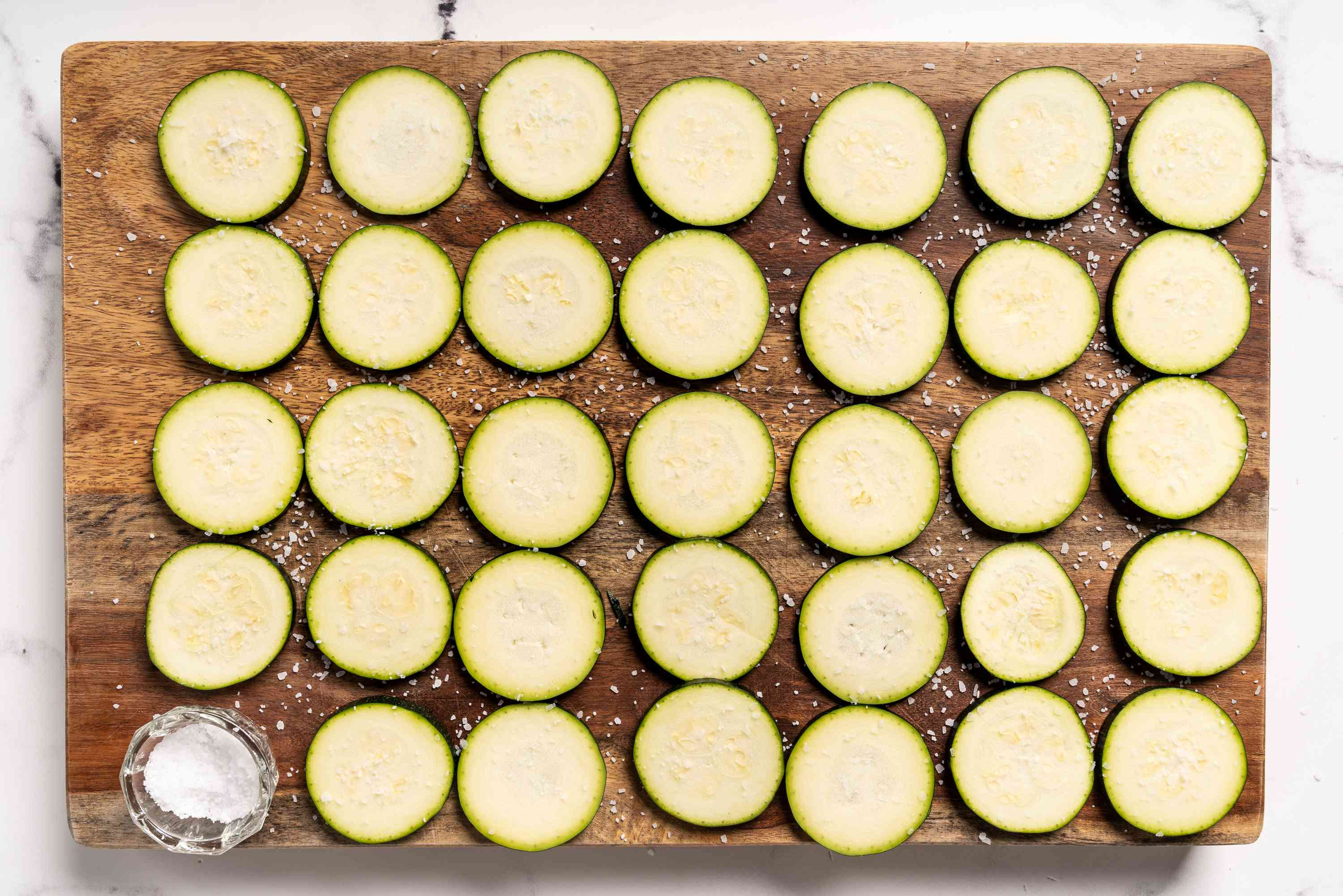 Zucchini slices sprinkled with salt