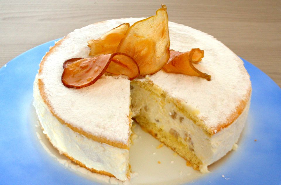 Ricotta and pear cake on blue plate