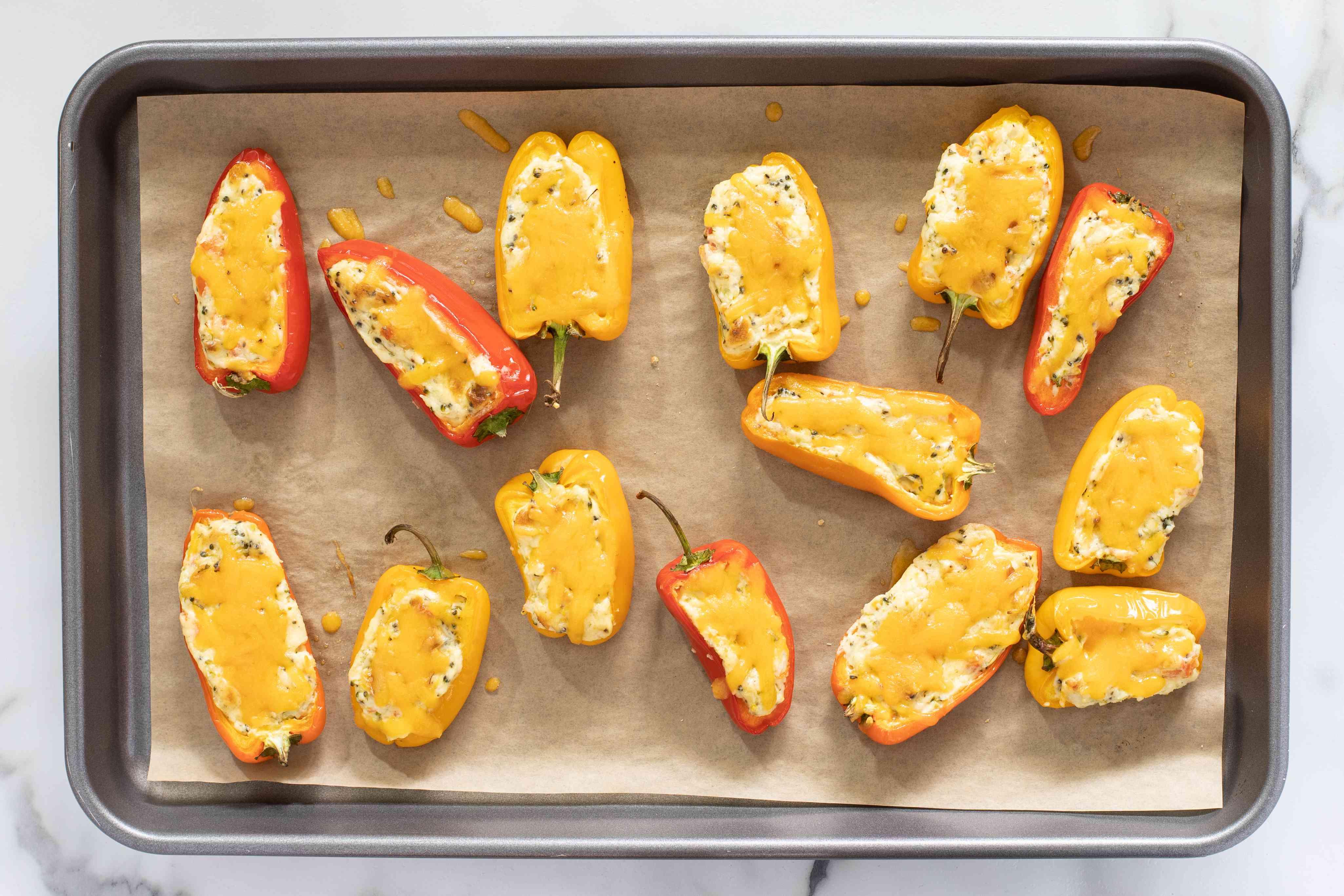 stuffed mini peppers on baking sheet