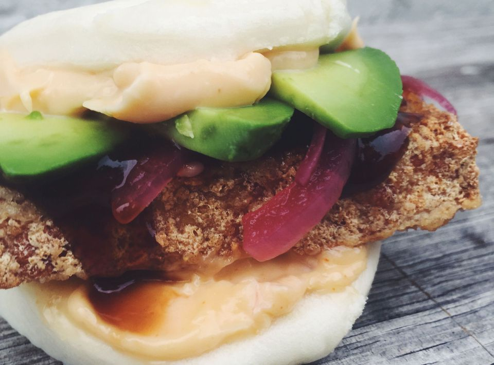 Close up of 5 Spice Fried Tofu Bao with Avocado, Pickled Red Onion + Kimchi-Mayo