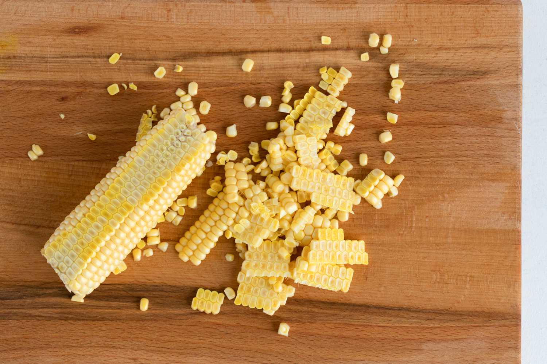 Corn cut off the cob on a cutting board