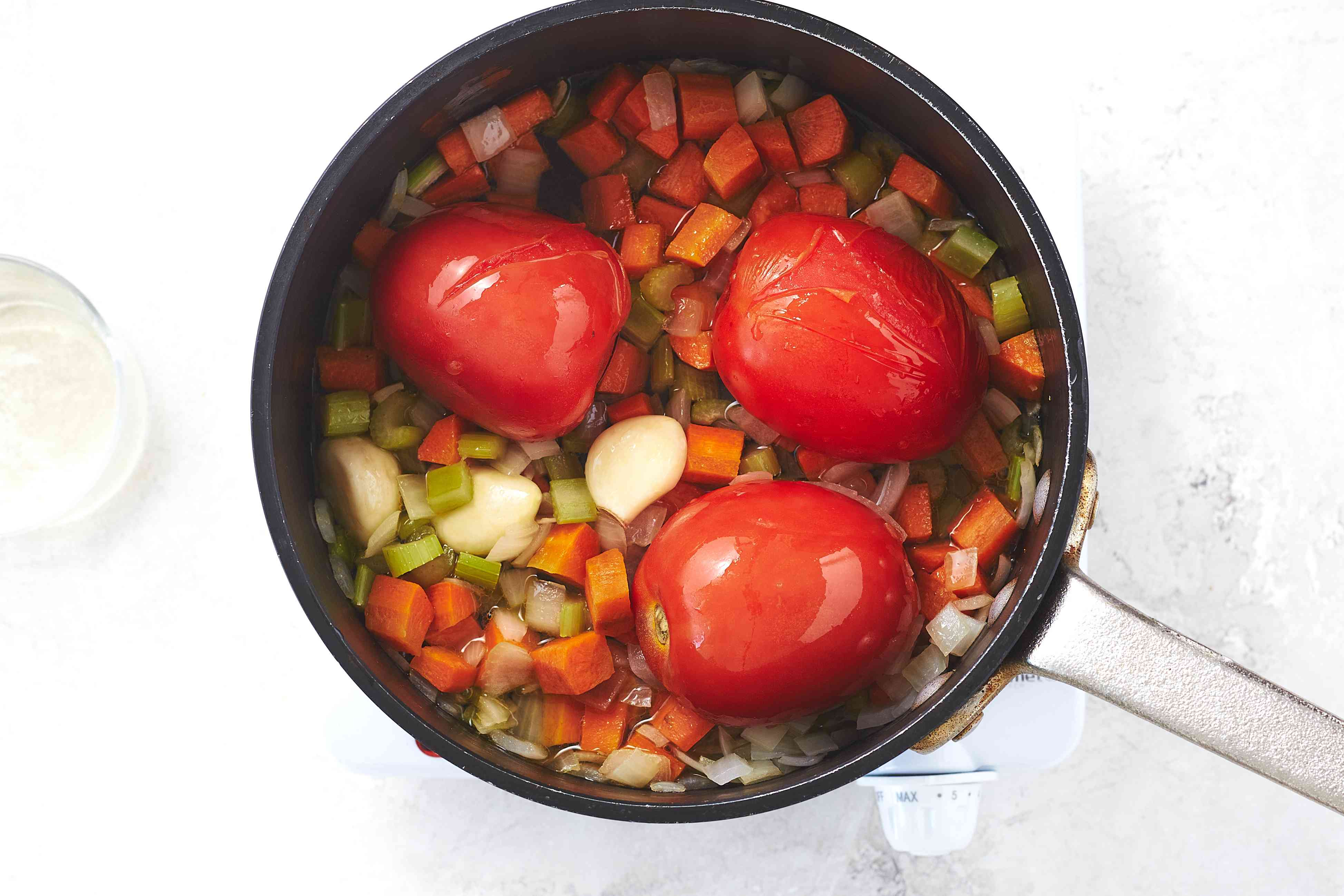 add wine to the vegetable mixture
