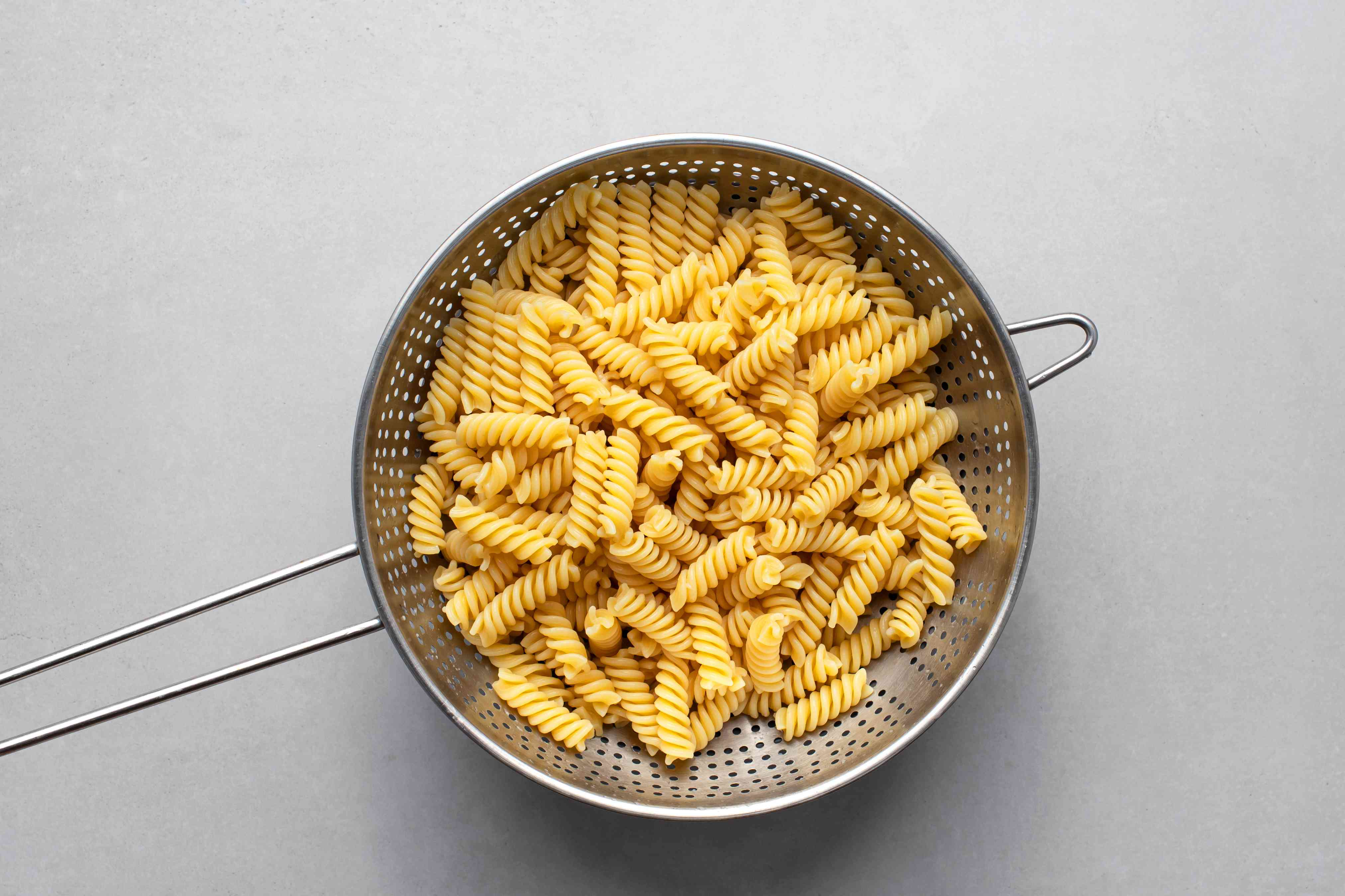 cooked pasta in a colander