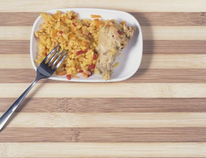 Spanish tapa of rice with chicken over a wooden surface