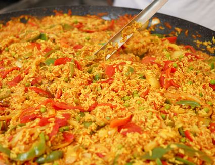 Vegan paella with green peas, artichokes and bell pepper photo by Fuse / Getty Images