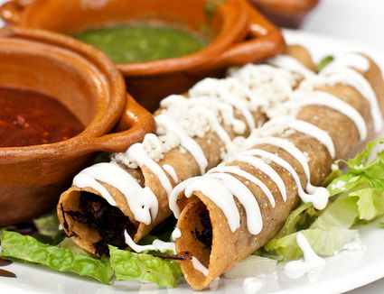 A set of taquitos on a plate