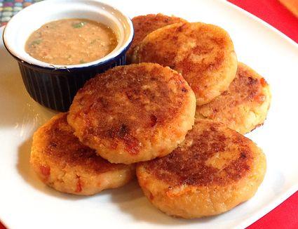 Llapingachos (Ecuadorian Potato Pancakes) with sauce on plate