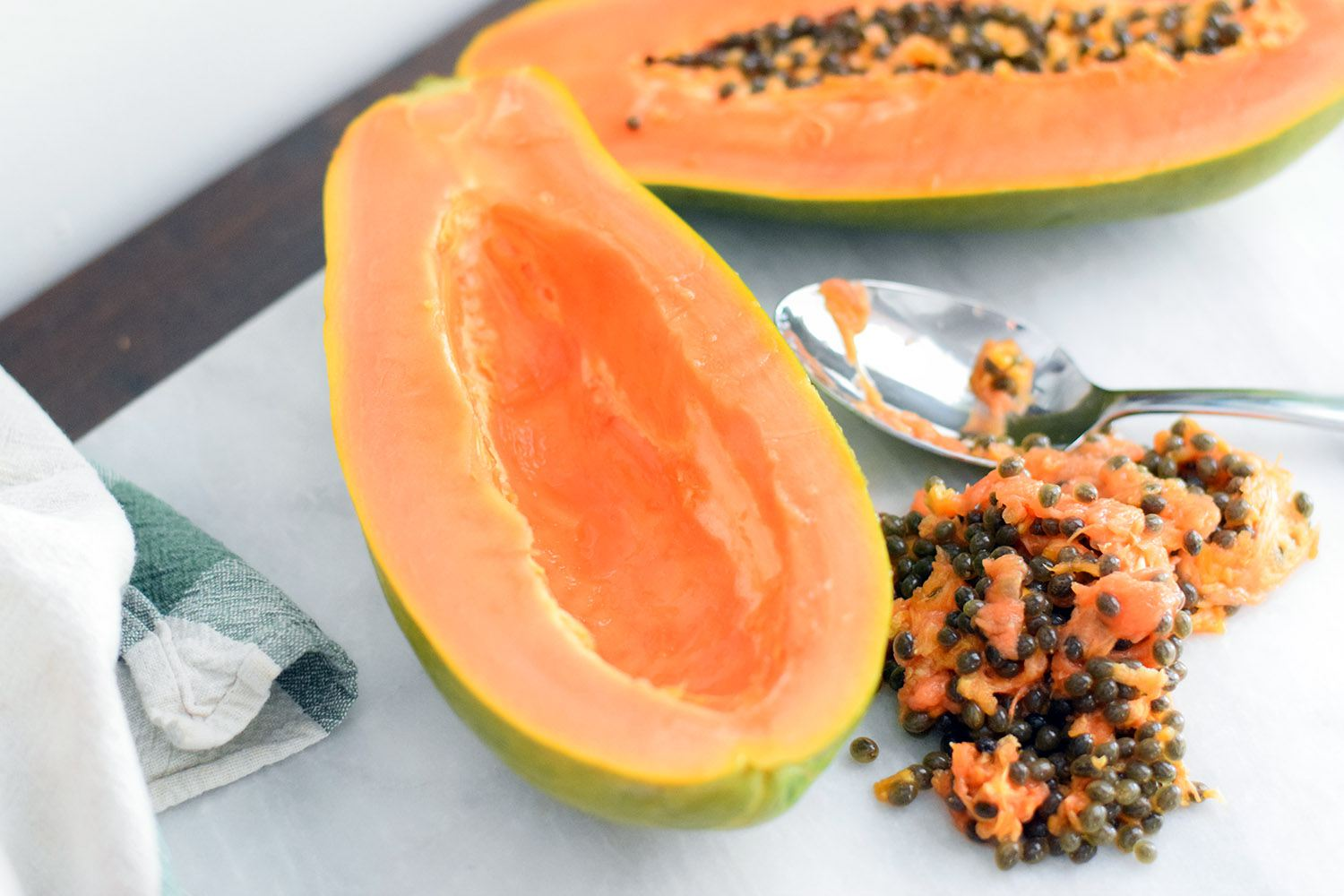 Scrape papaya seeds out with a spoon
