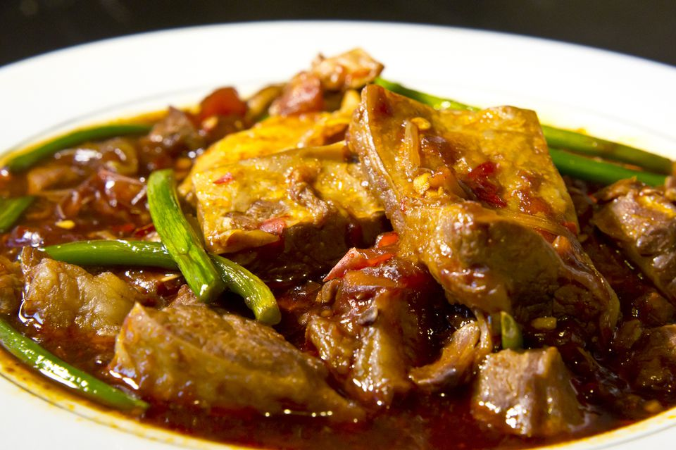 Chinese curried beef in white bowl
