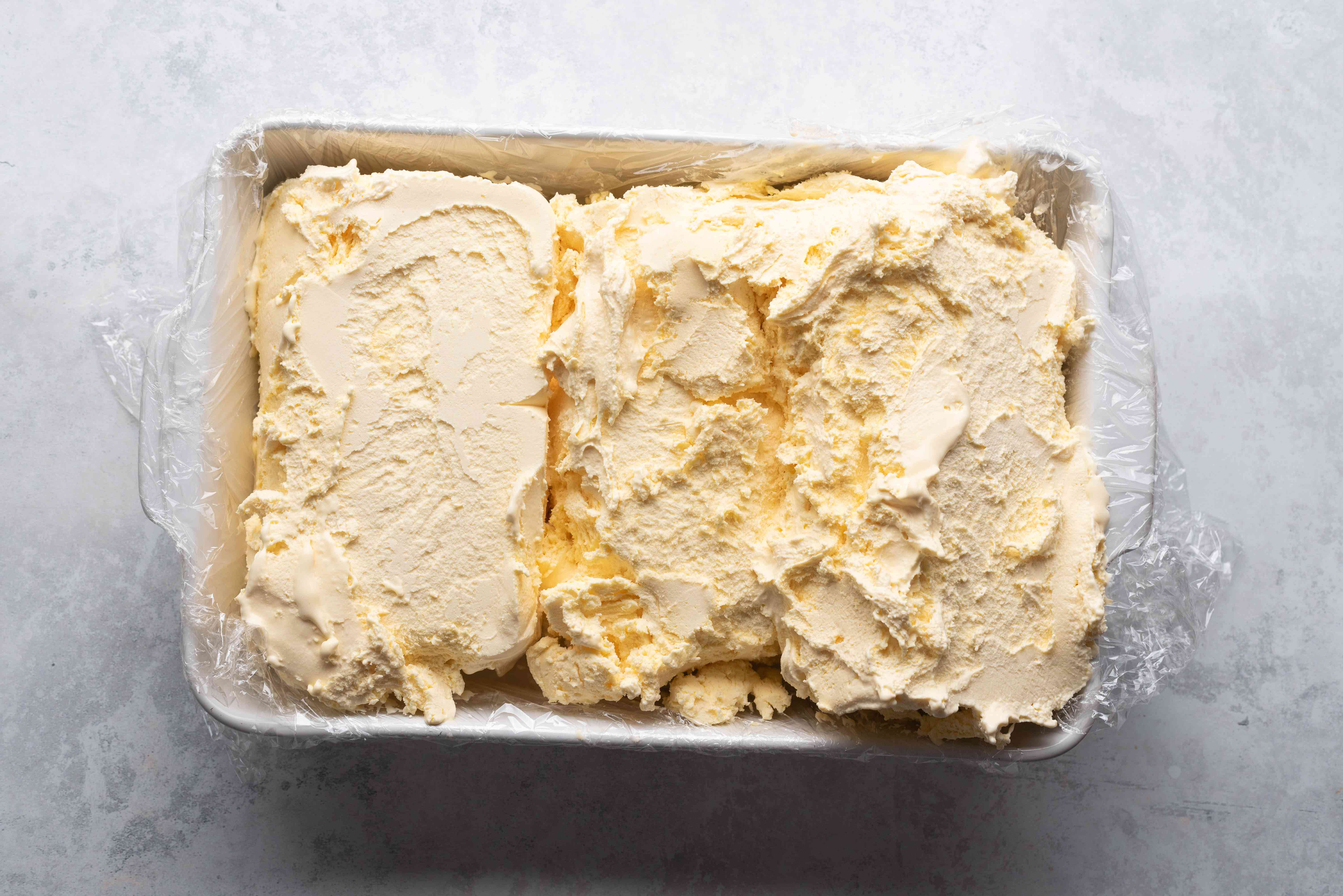 Remove the ice cream from the containers and place the ice cream bricks on their sides in the pan
