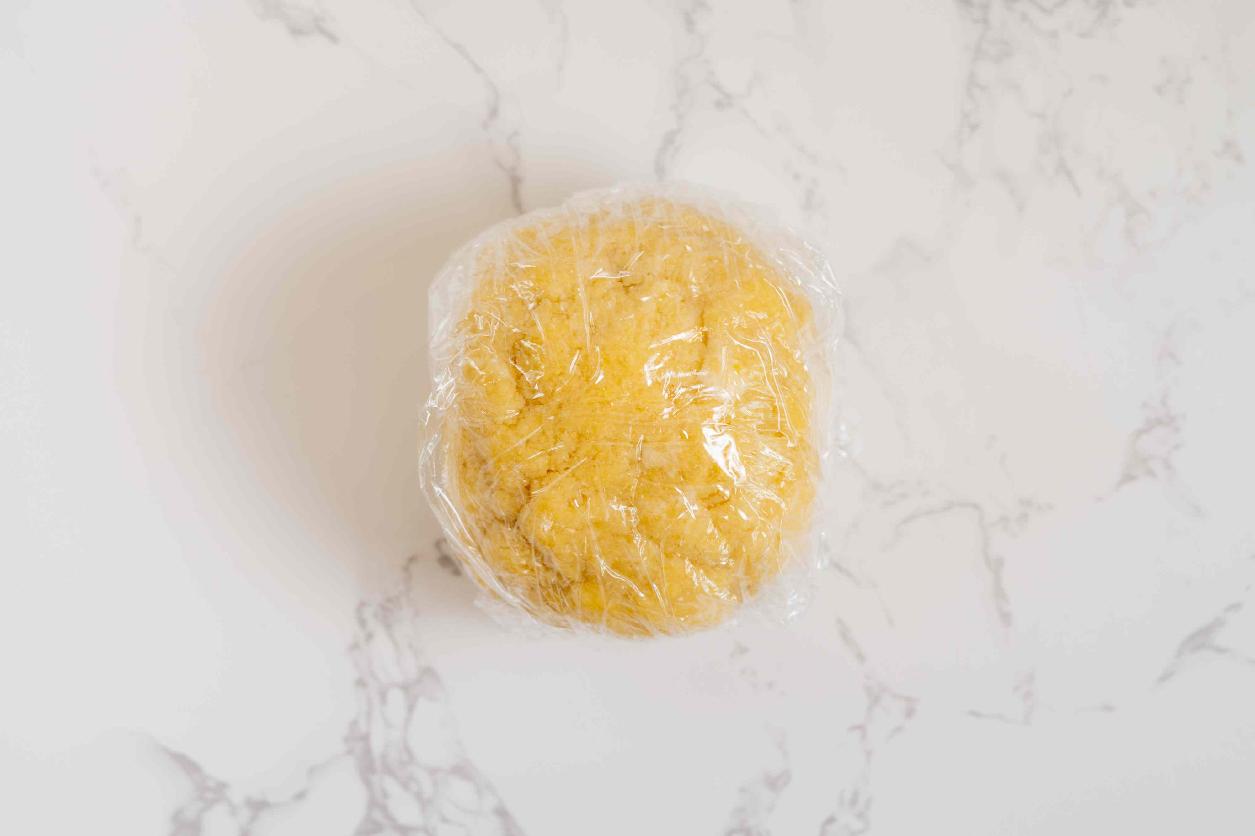 dough ball wrapped in plastic