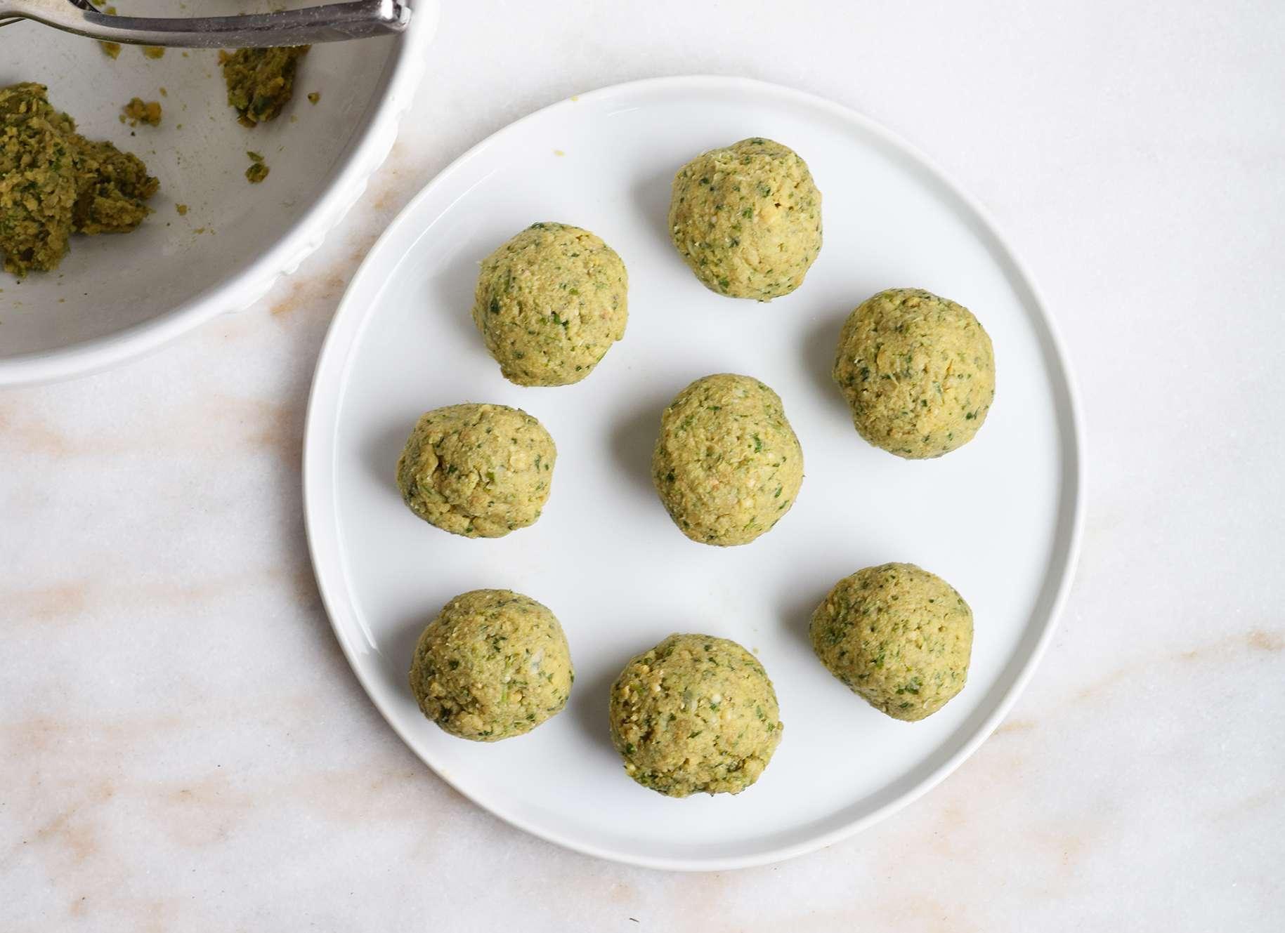 falafel balls formed on a plate
