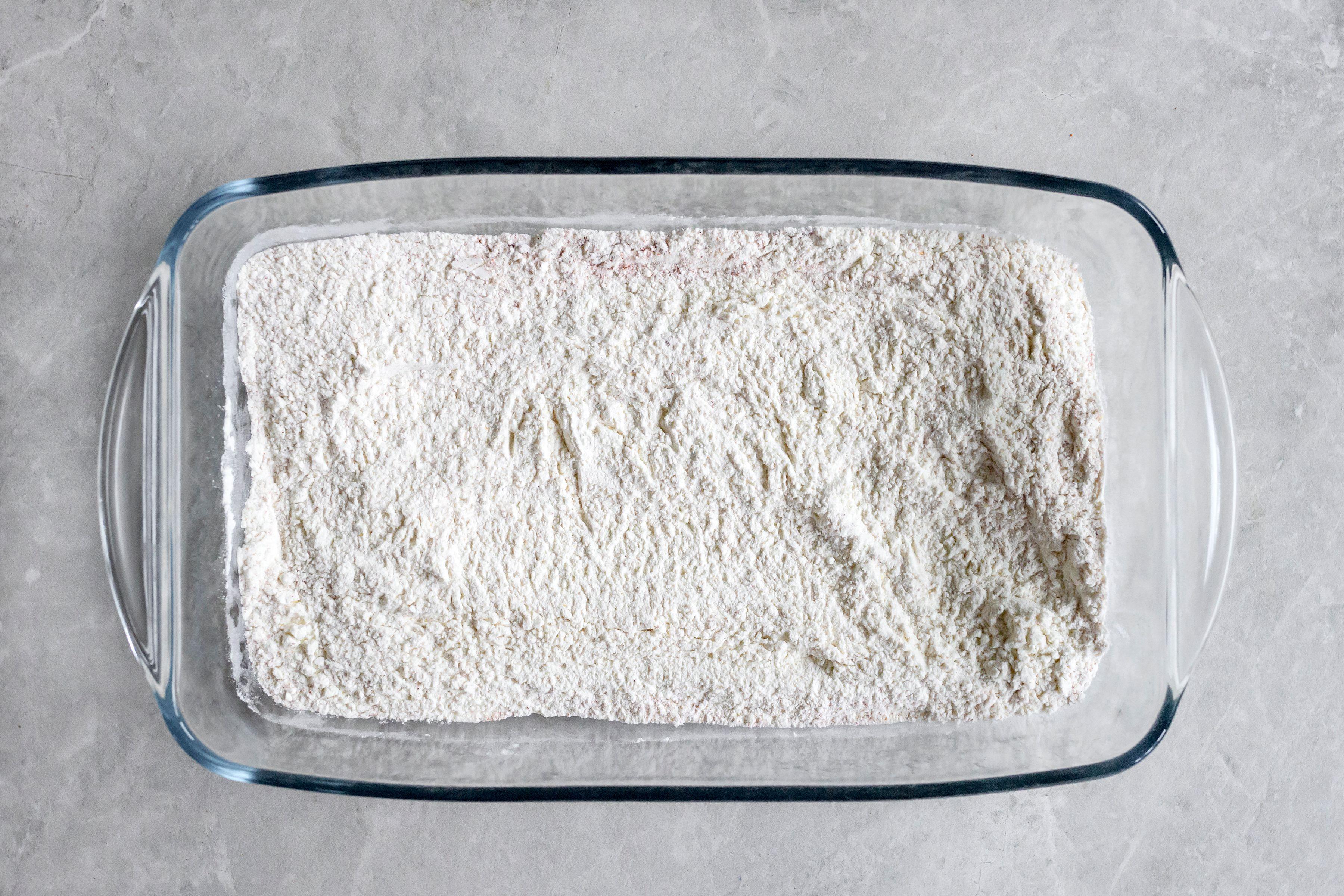 Flour lining bottom of baking dish