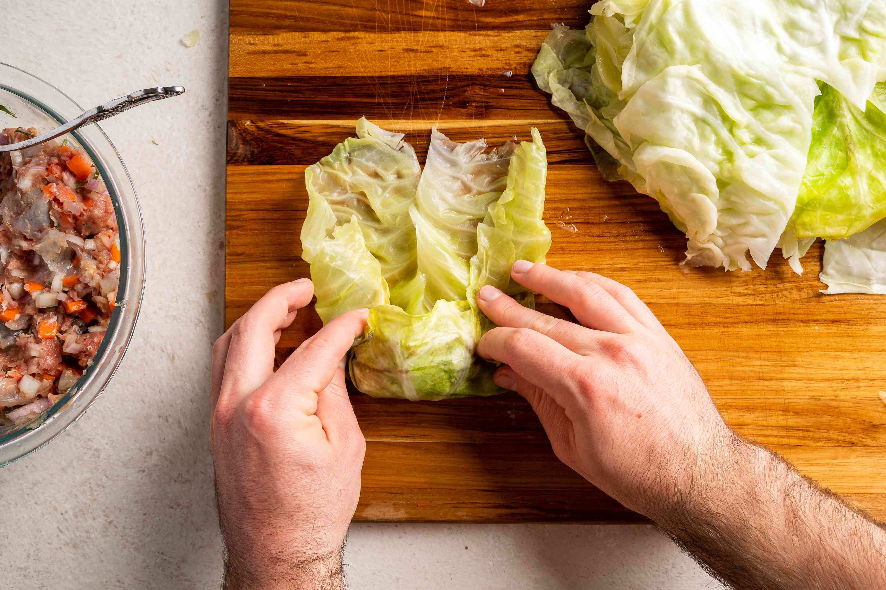 Take the side cabbage edges and fold in