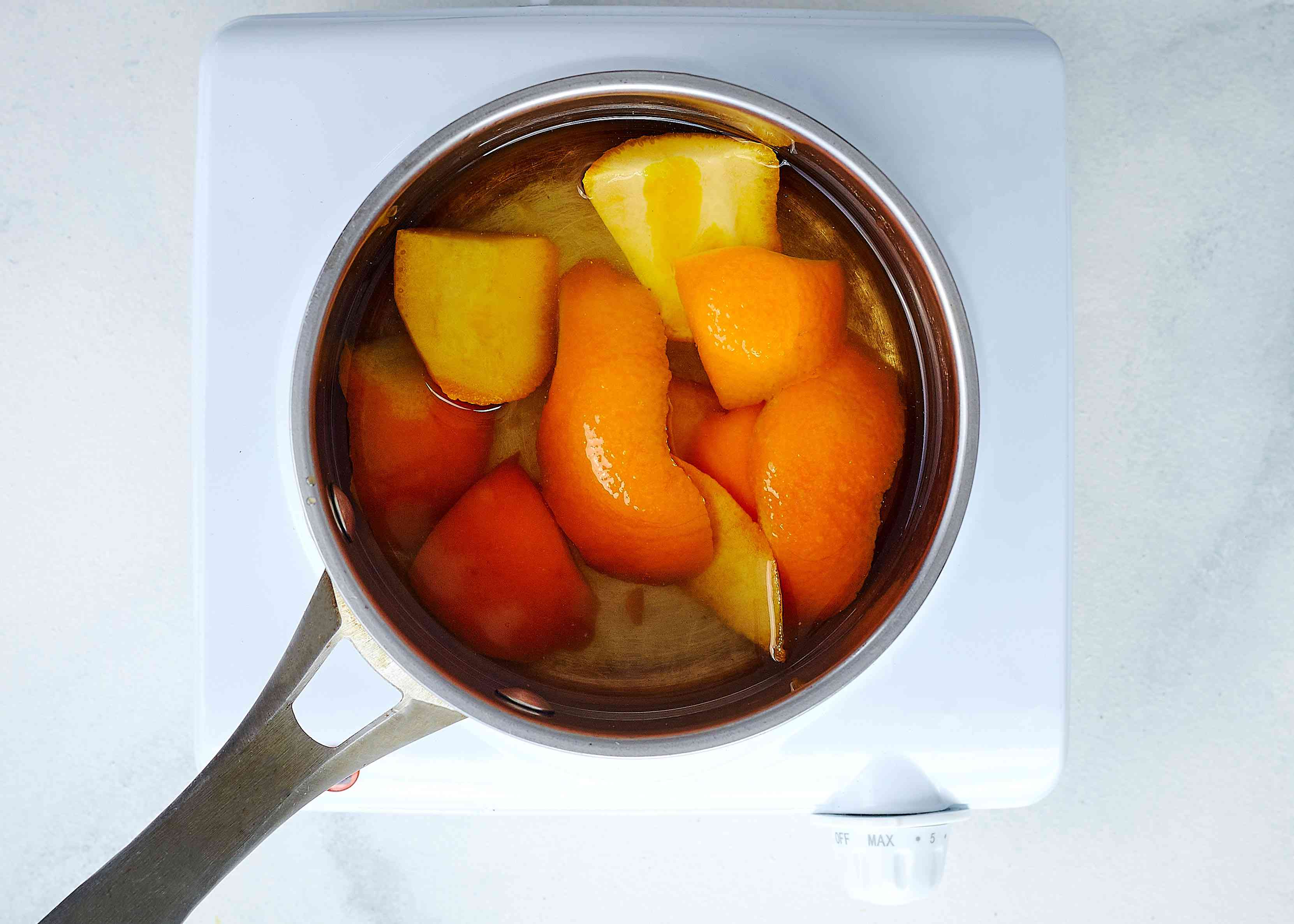 Orange simple syrup ingredients in a pot