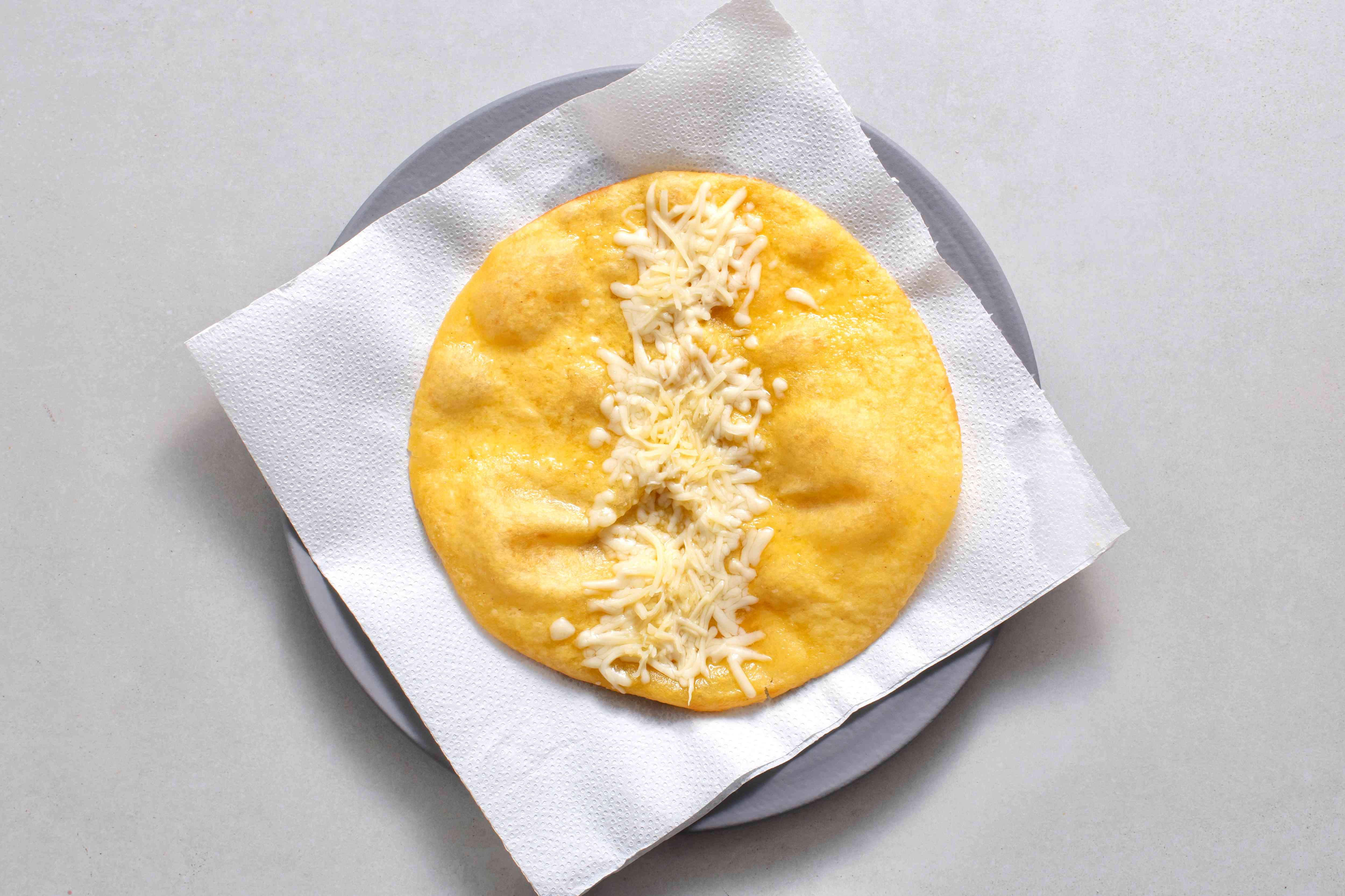 tortilla with cheese on top