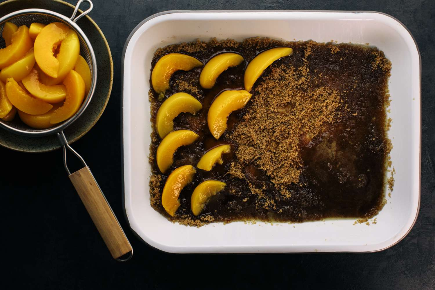 peach slices on top of the brown sugar in a baking pan