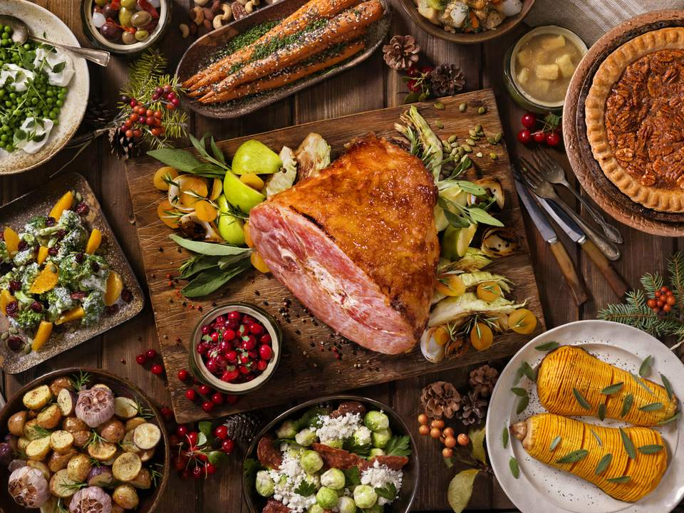 Classic thanksgiving menu with recipes roasted ham on thanksgiving table forumfinder Choice Image
