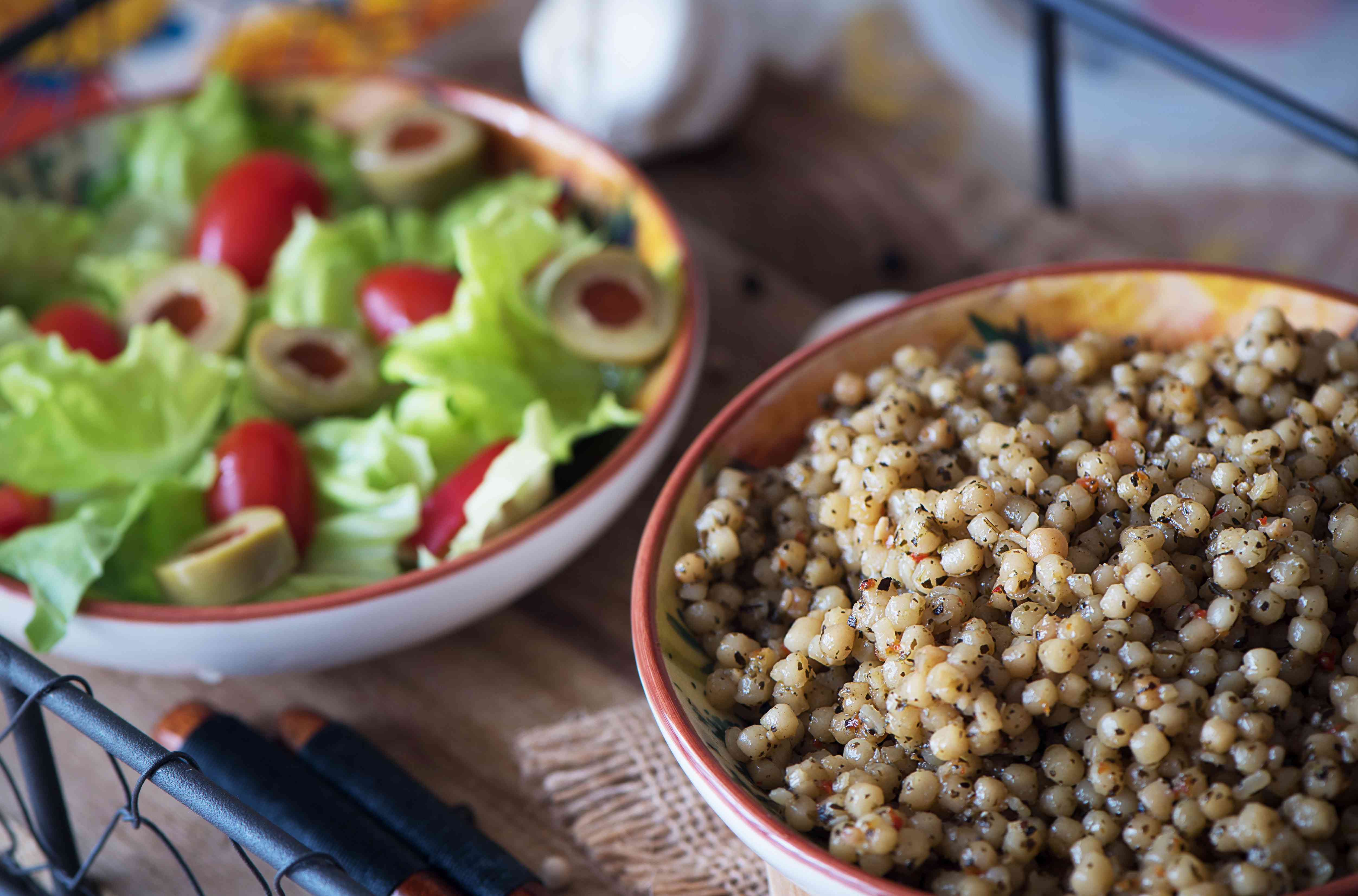 Couscous and lettuce salad, tomatoes and olives