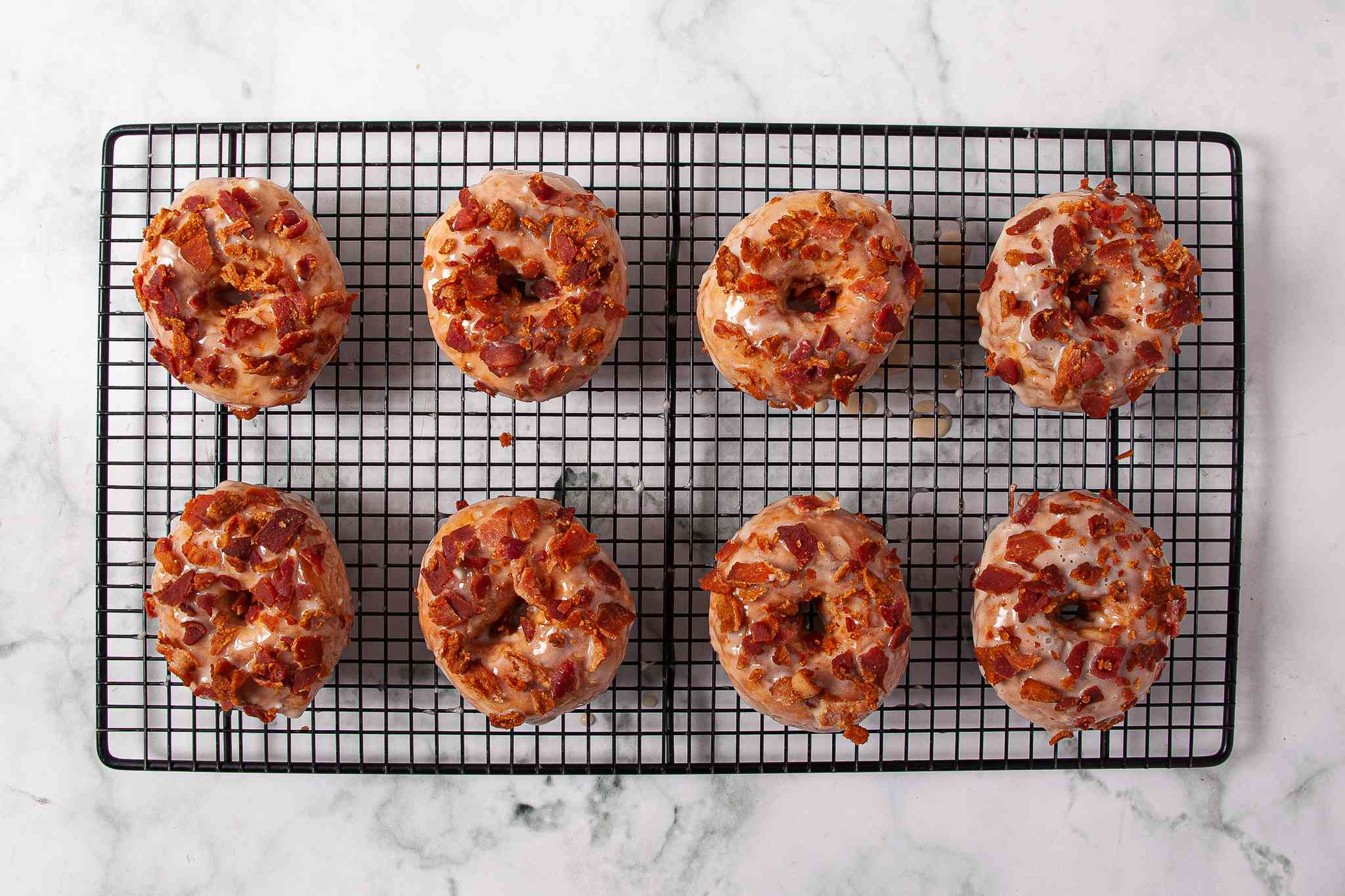 Maple Bacon Doughnuts on a cooling rack