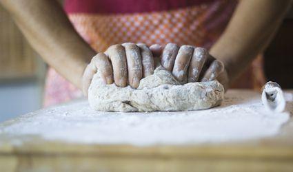 Woman kneading dough in kitchen