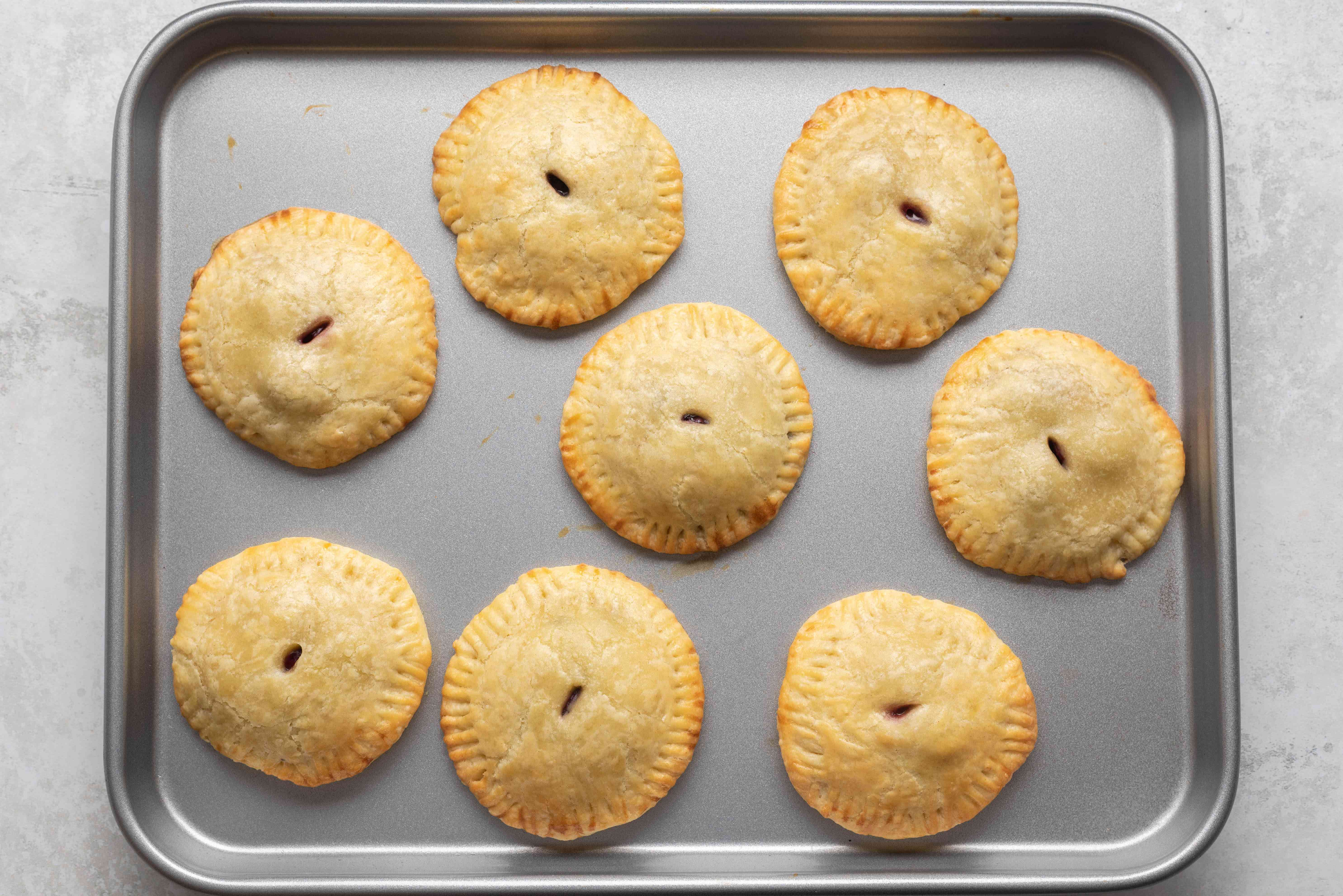 baked pies on a baking sheet