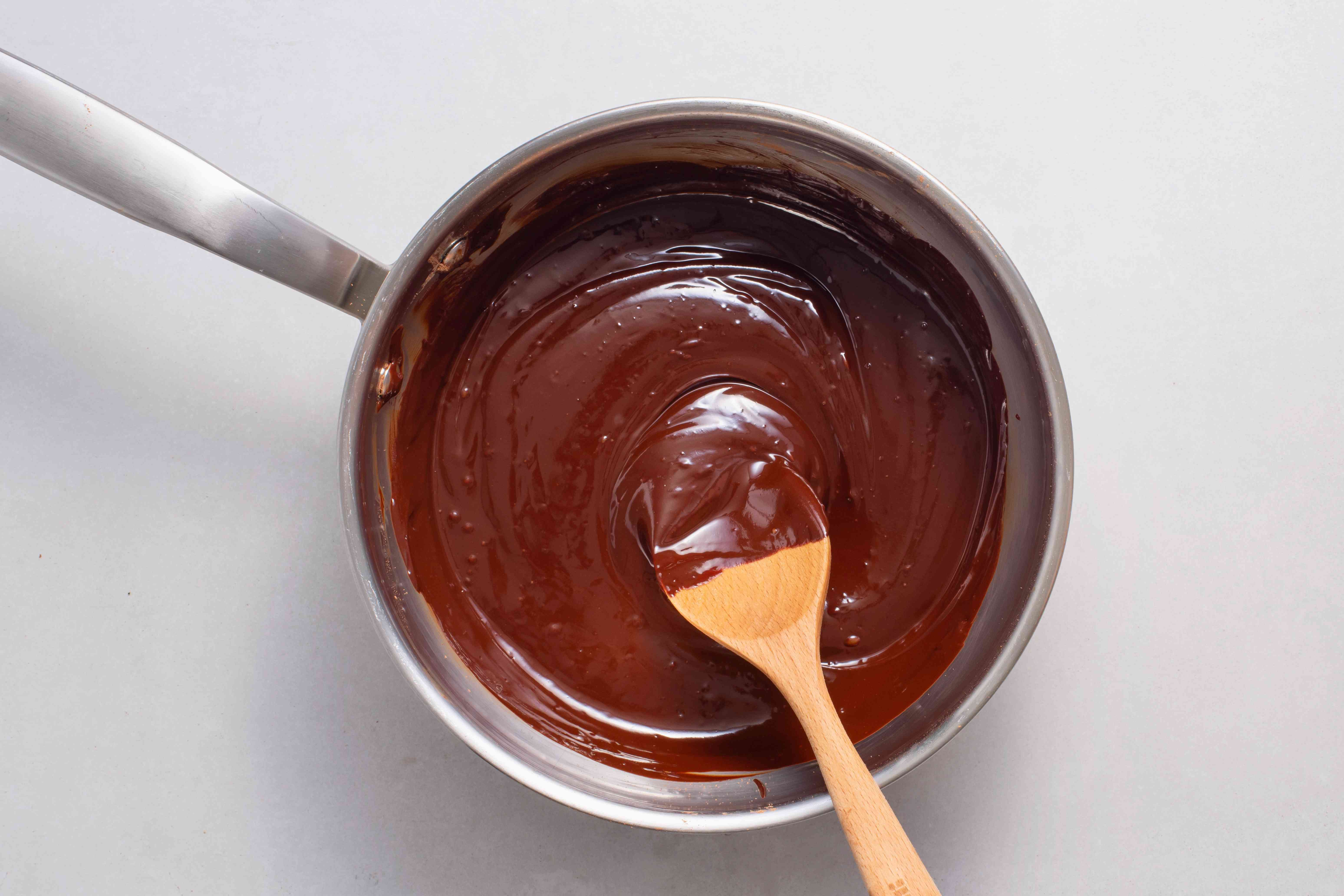 cocoa powder and espresso powder added to the chocolate in the saucepan