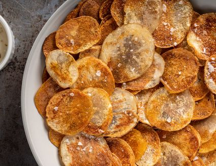 A bowl of baked potato chips