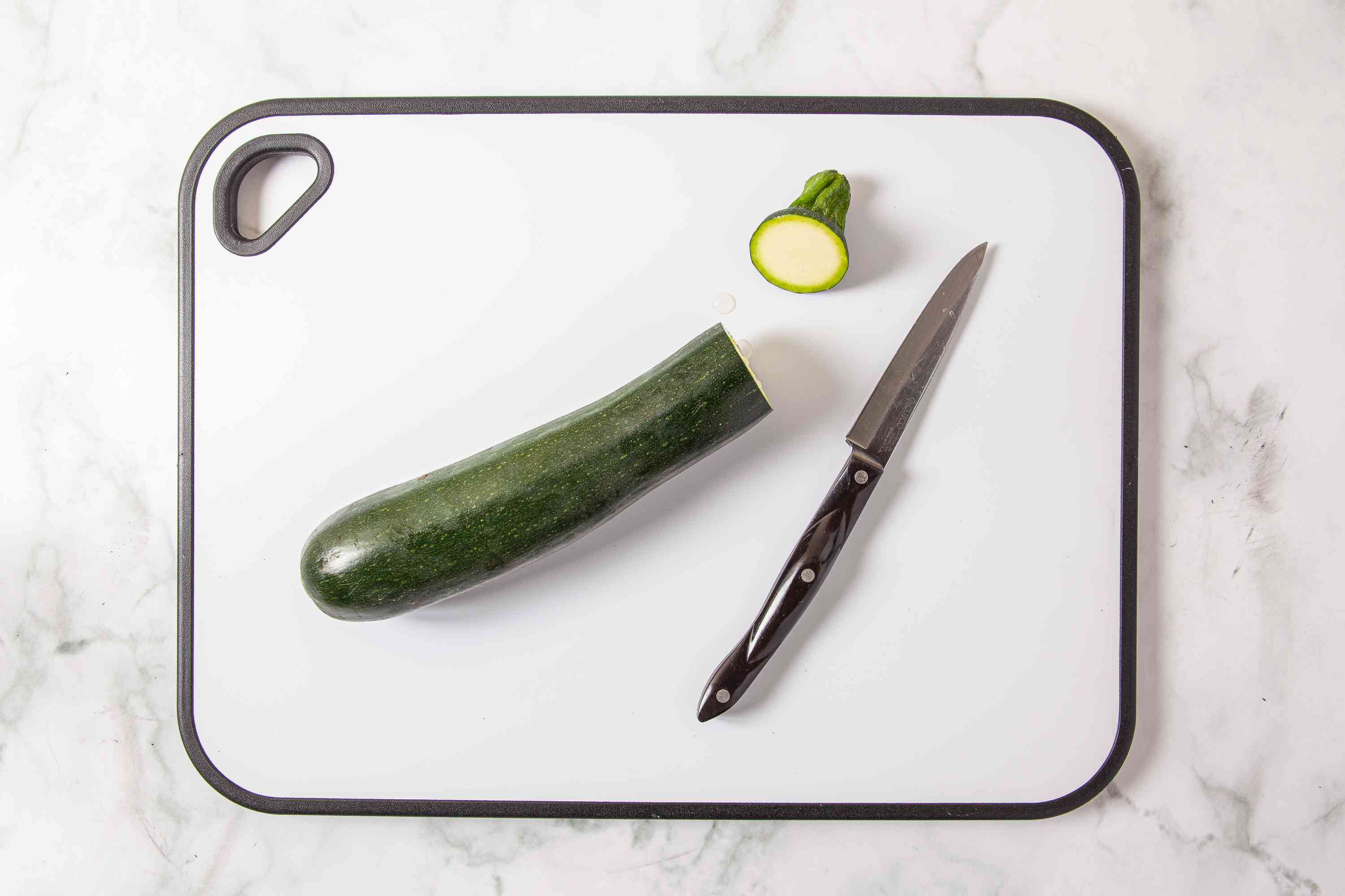 Zucchini on a cutting board with the top cut off