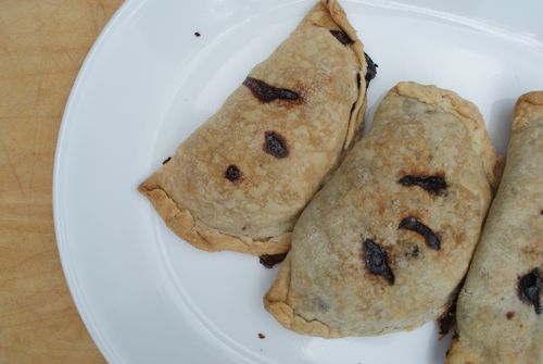 A plate of blueberry turnovers