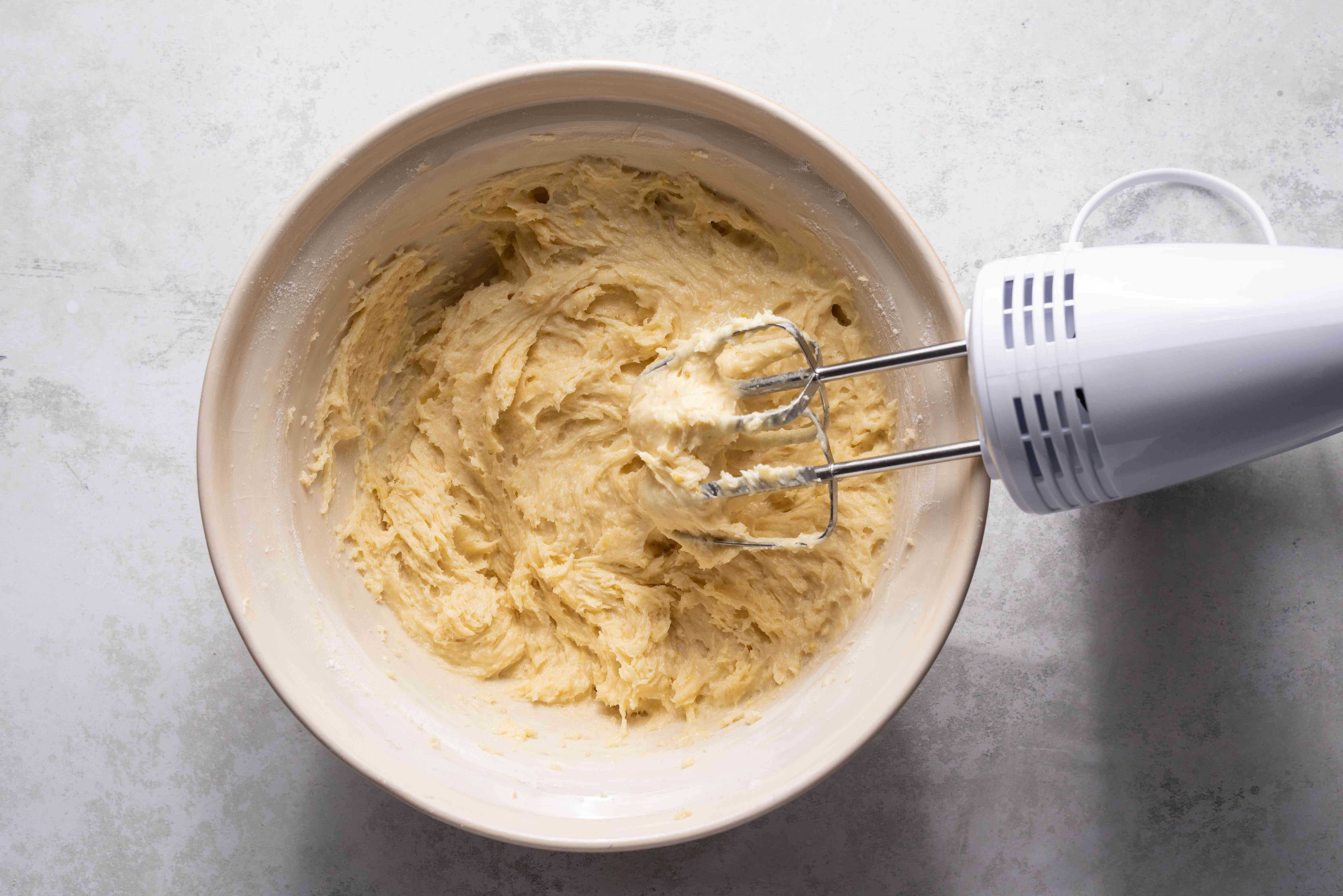 cookie batter in a bowl, hand mixer